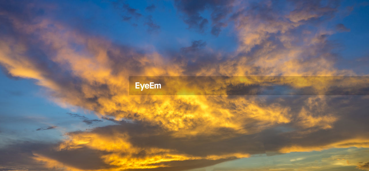 cloud - sky, sky, beauty in nature, sunset, scenics - nature, low angle view, tranquility, tranquil scene, nature, orange color, no people, idyllic, dramatic sky, outdoors, backgrounds, blue, non-urban scene, yellow, cloudscape, meteorology