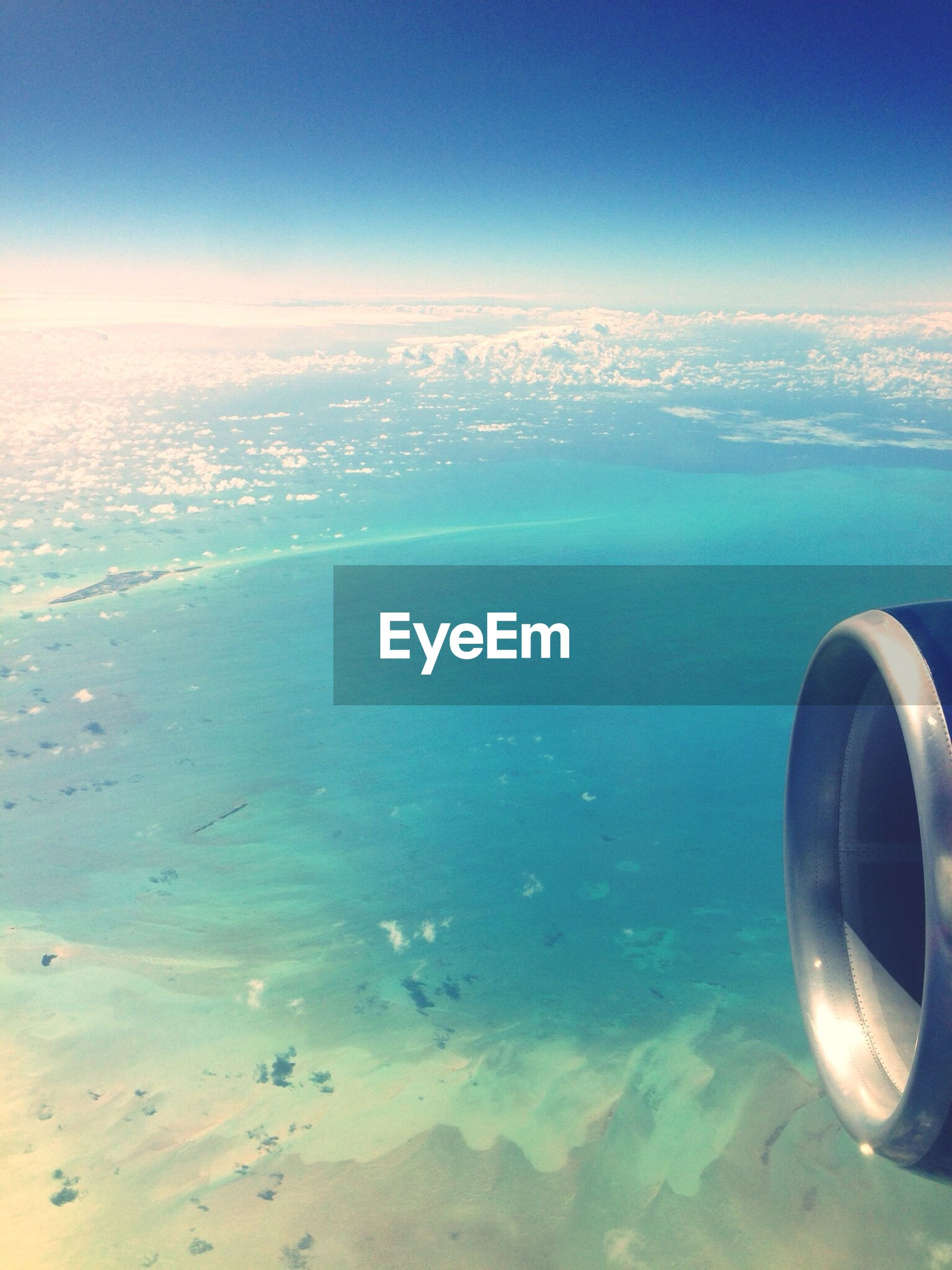 sea, water, scenics, sky, horizon over water, beauty in nature, tranquil scene, blue, tranquility, aerial view, nature, transportation, airplane, mode of transport, idyllic, cloud - sky, seascape, coastline, travel, air vehicle