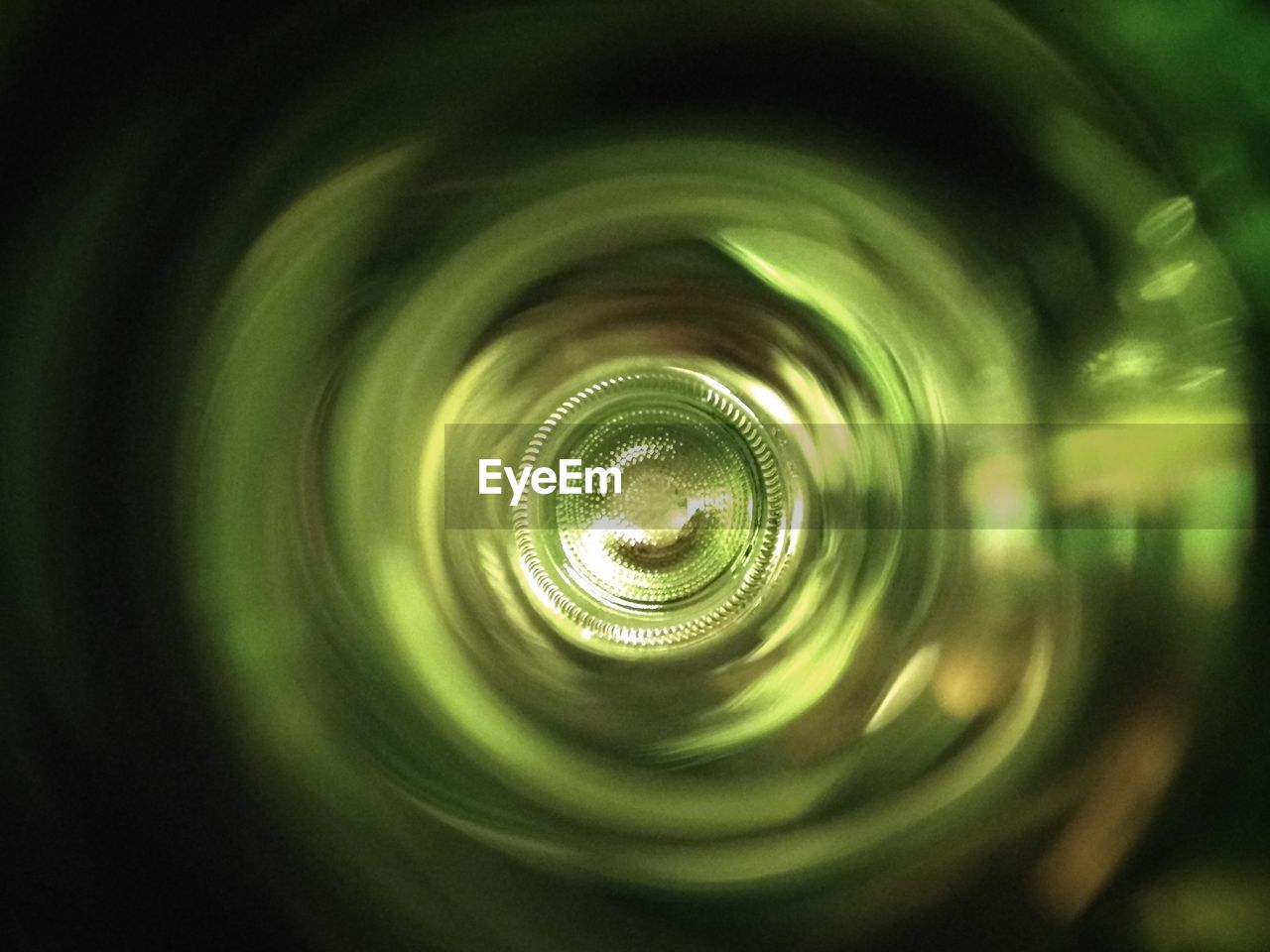 close-up, no people, pattern, selective focus, green color, spiral, full frame, backgrounds, geometric shape, directly above, indoors, circle, glass - material, shape, nature, abstract, day, bottle, glass