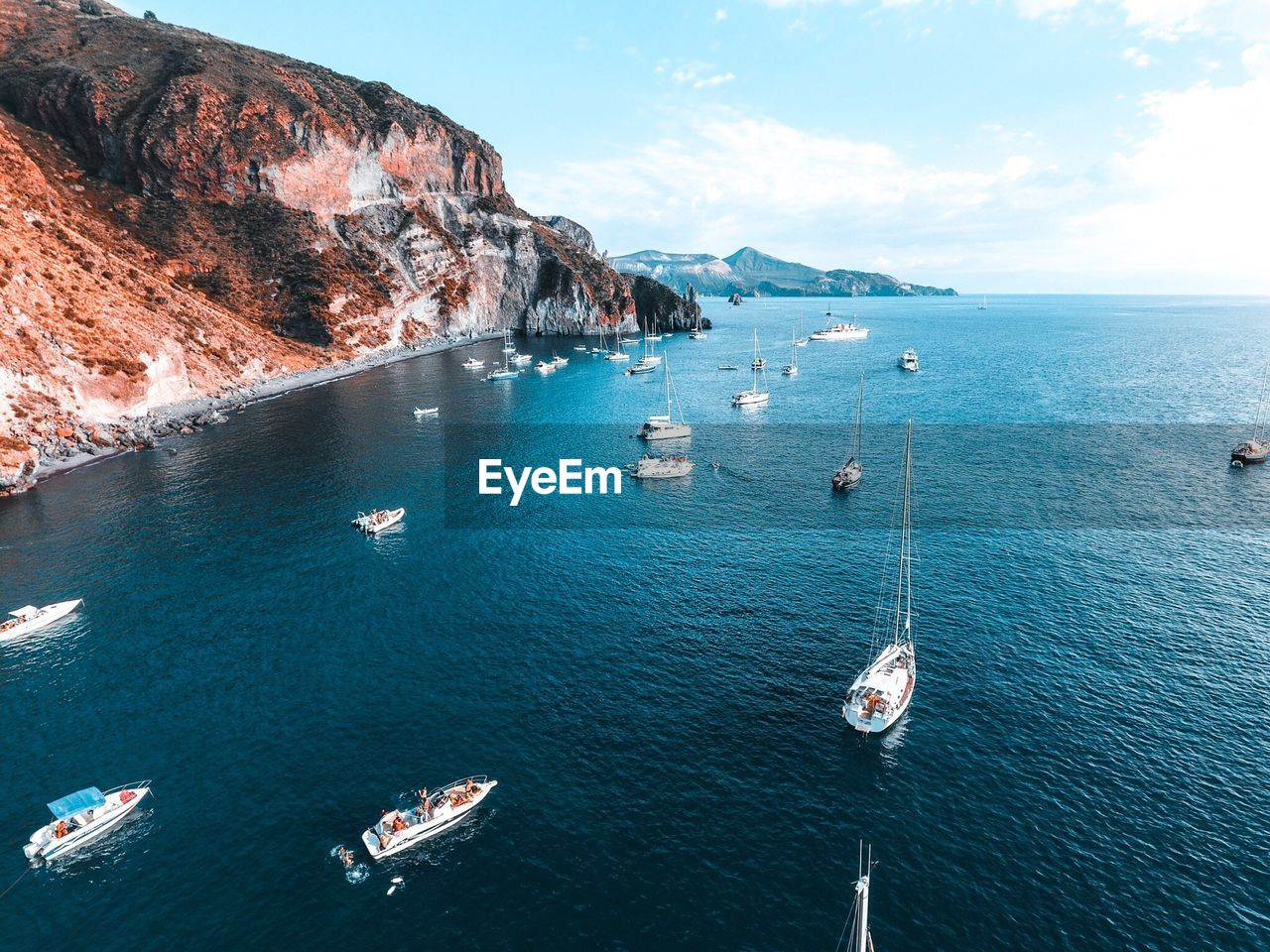 Scenic View Of Boats On Sea
