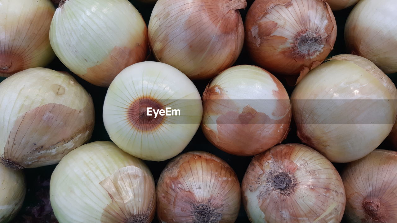 Full frame shot of onions for sale in market
