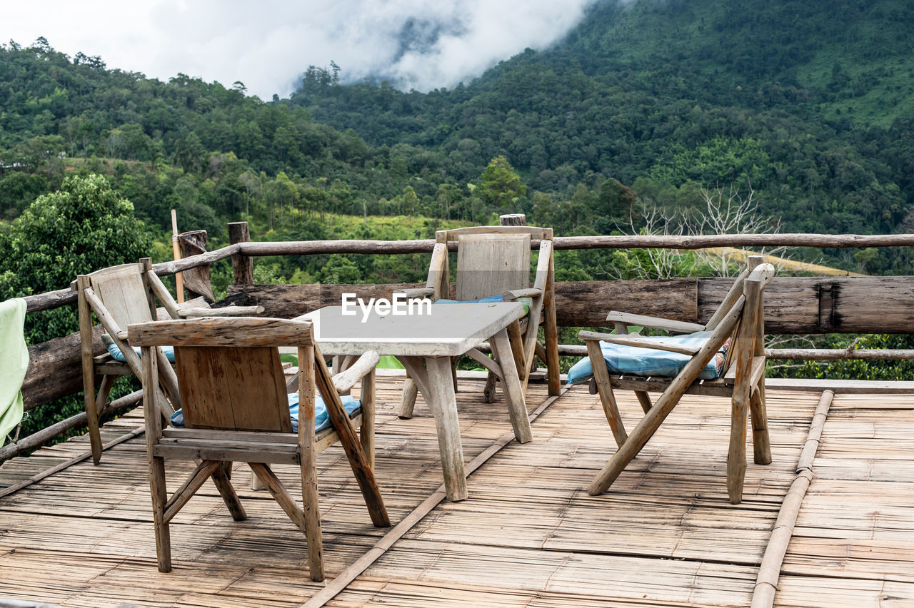 wood - material, plant, nature, tree, seat, no people, table, chair, day, landscape, absence, empty, sky, green color, mountain, wood, tranquil scene, scenics - nature, land, tranquility, outdoors