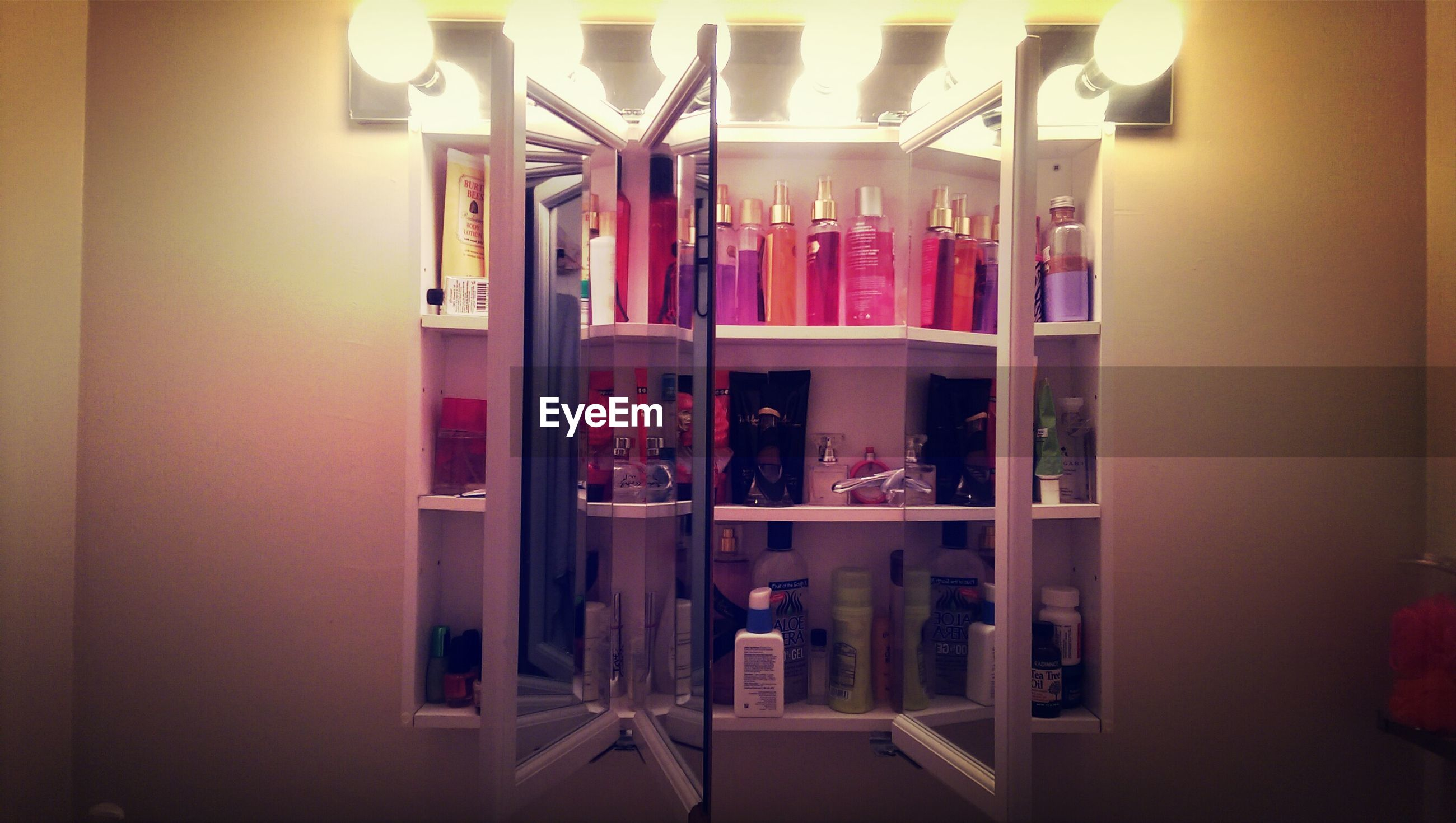 Beauty Products Arranged On Shelves
