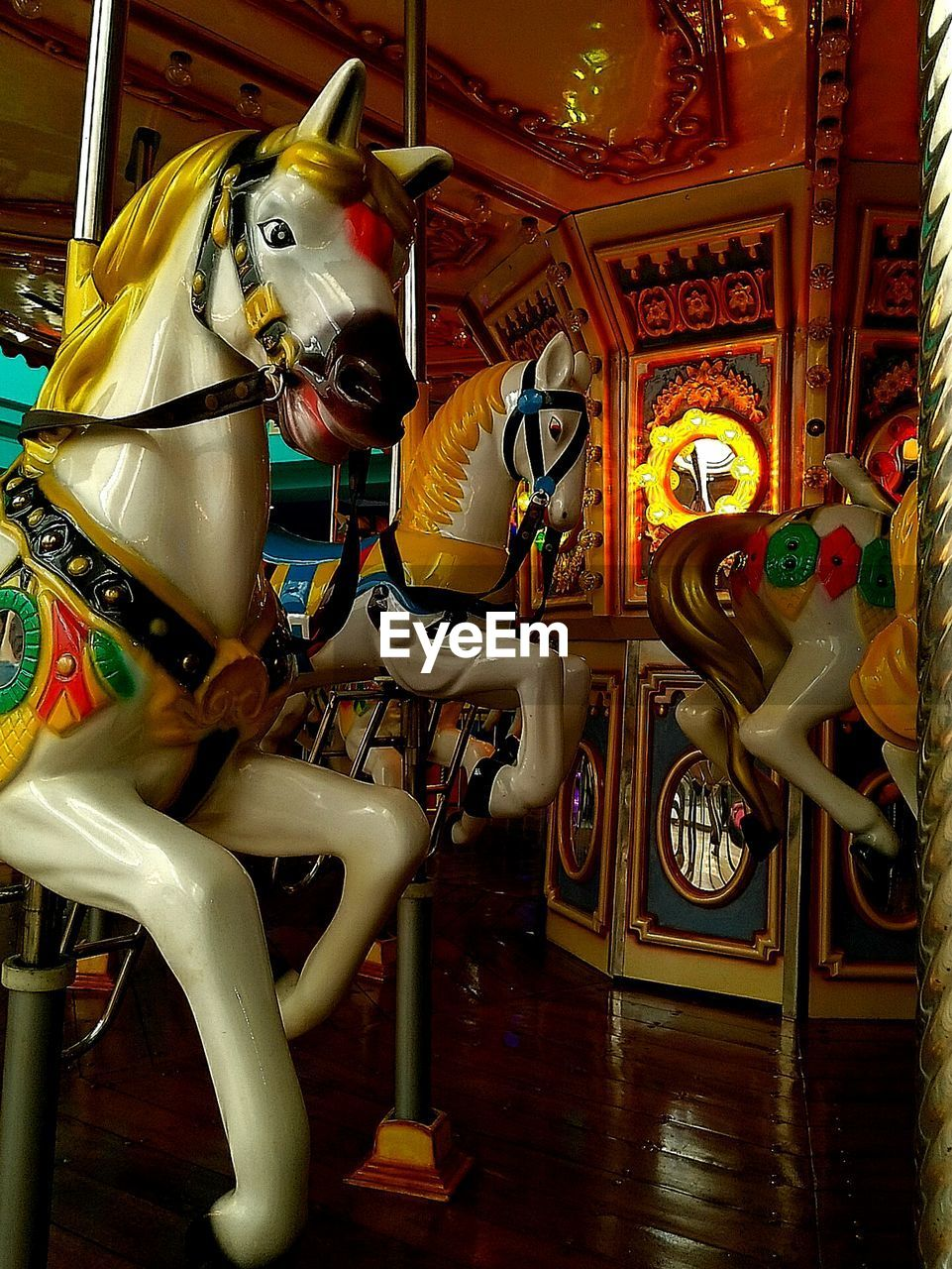 amusement park, carousel horses, horse, animal representation, carousel, amusement park ride, arts culture and entertainment, no people, illuminated, night, enjoyment, merry-go-round, indoors