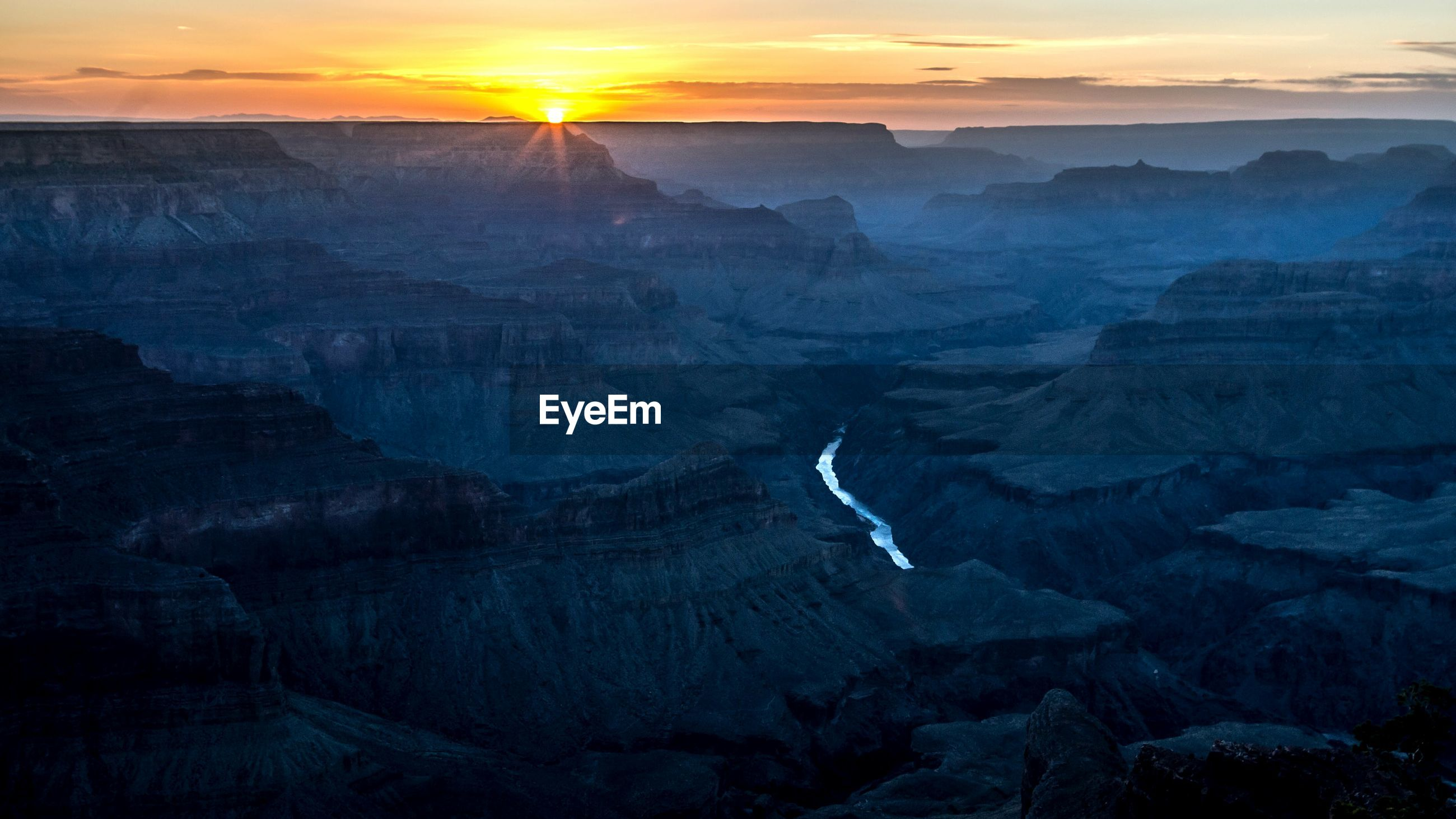 Colorado river in grand canyon national park against sky during sunset
