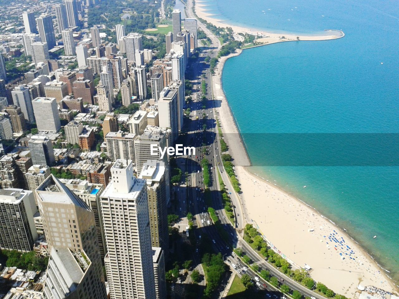 High Angle View Of Beach By Cityscape