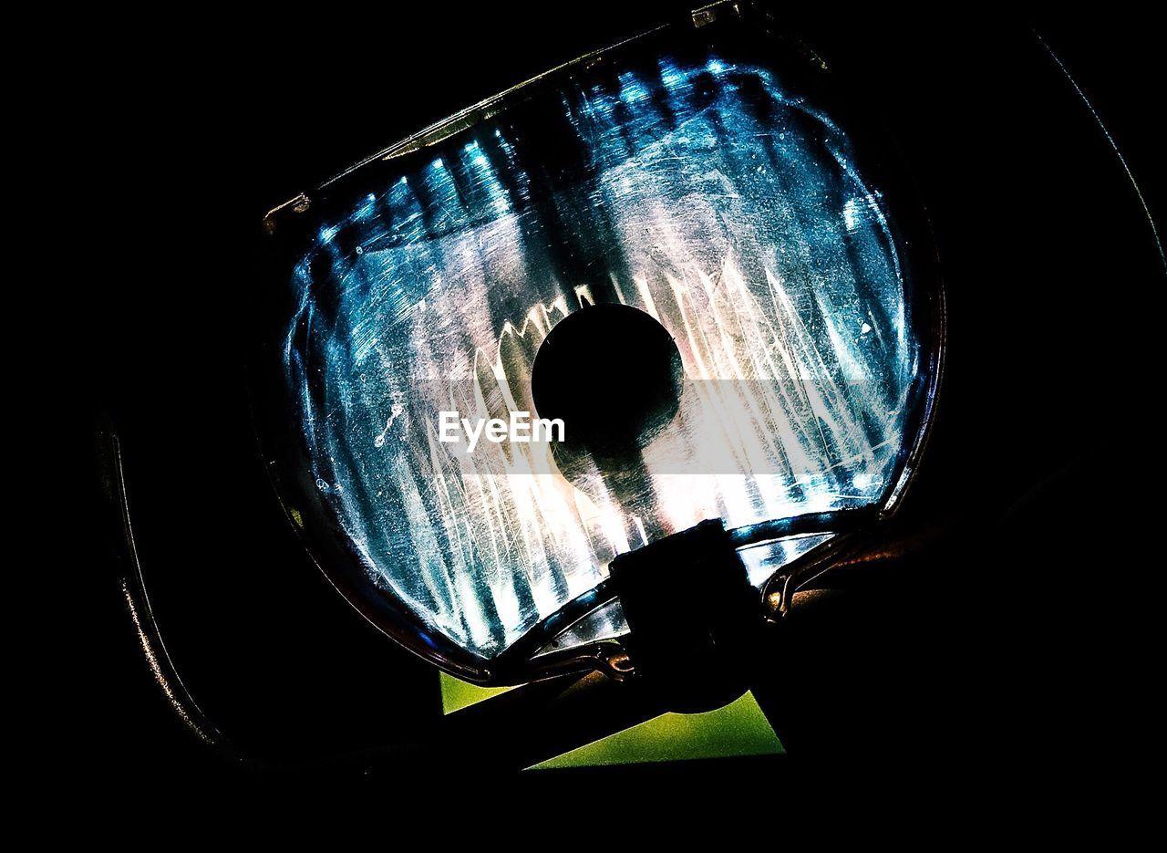 Low Angle View Of Lighting Equipment In Dark Room