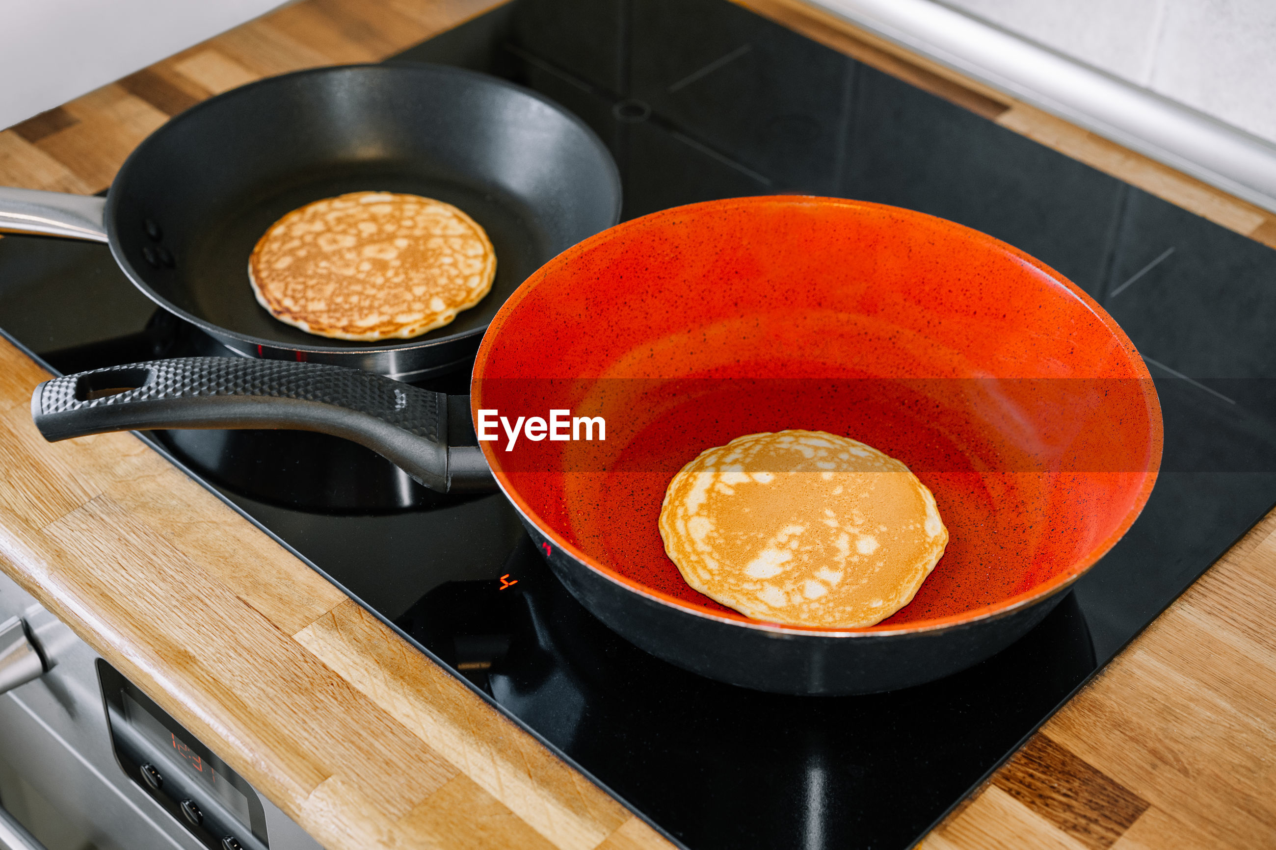 High angle view of panc with pancakes on stove at home