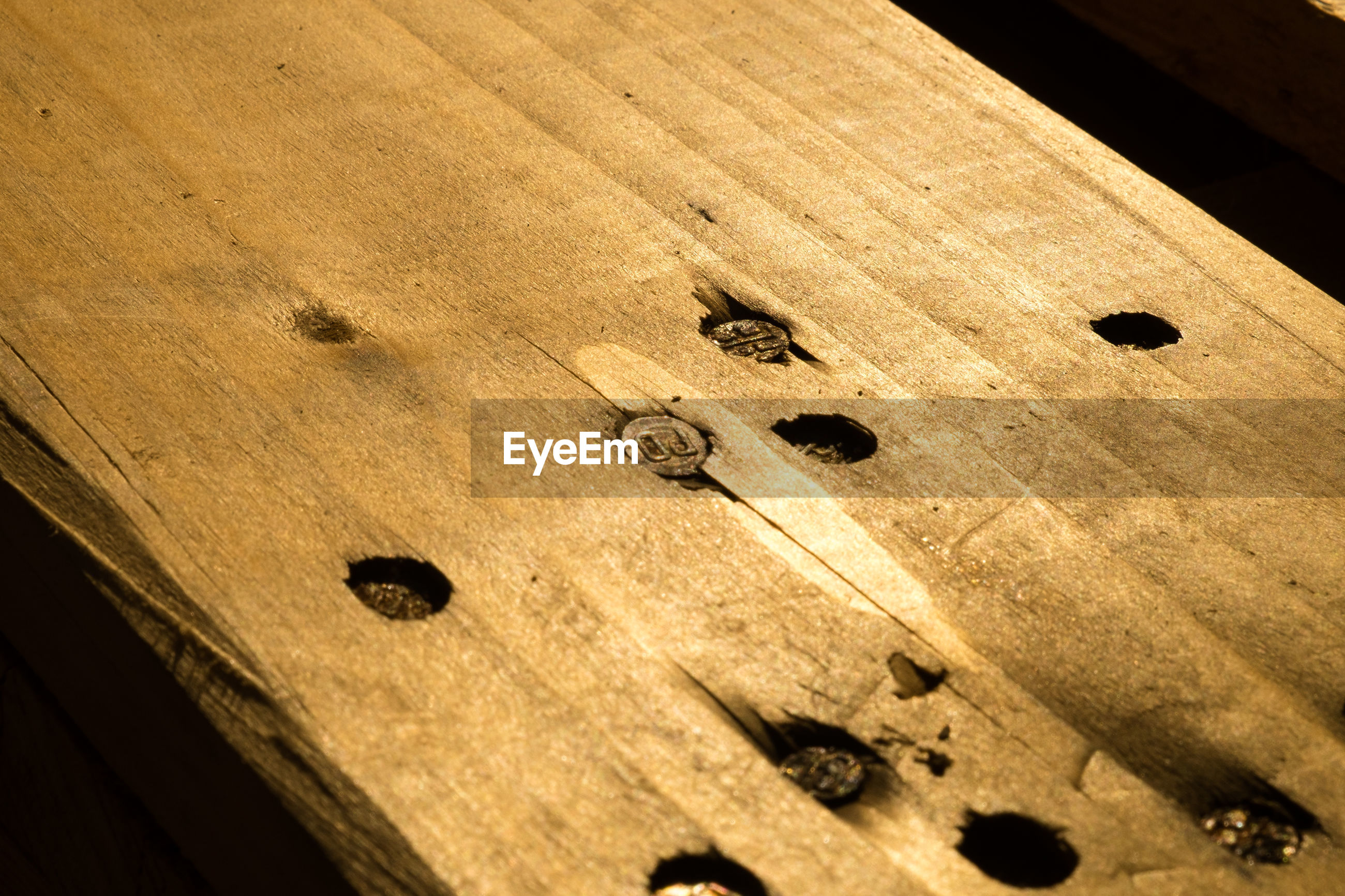 HIGH ANGLE VIEW OF WOOD ON WOODEN FLOOR