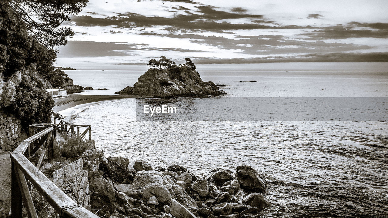 water, sky, cloud - sky, beauty in nature, rock, tranquility, nature, tranquil scene, sea, scenics - nature, no people, rock - object, tree, day, solid, plant, beach, land, outdoors