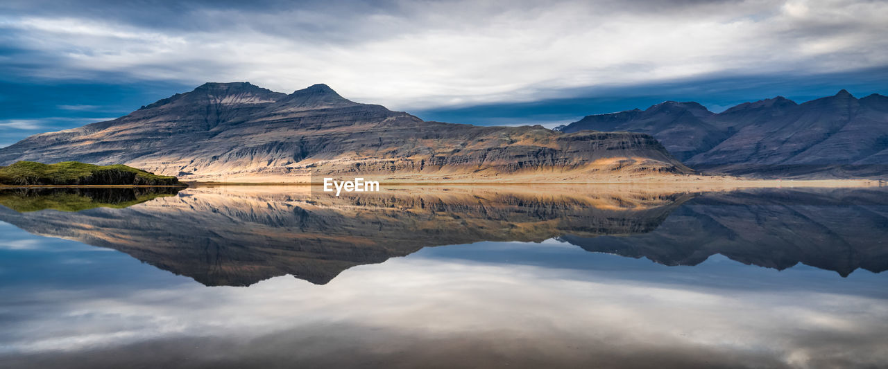 cloud - sky, sky, reflection, mountain, water, scenics - nature, beauty in nature, tranquil scene, lake, tranquility, waterfront, mountain range, non-urban scene, idyllic, nature, symmetry, no people, day, remote, outdoors, mountain peak, reflection lake