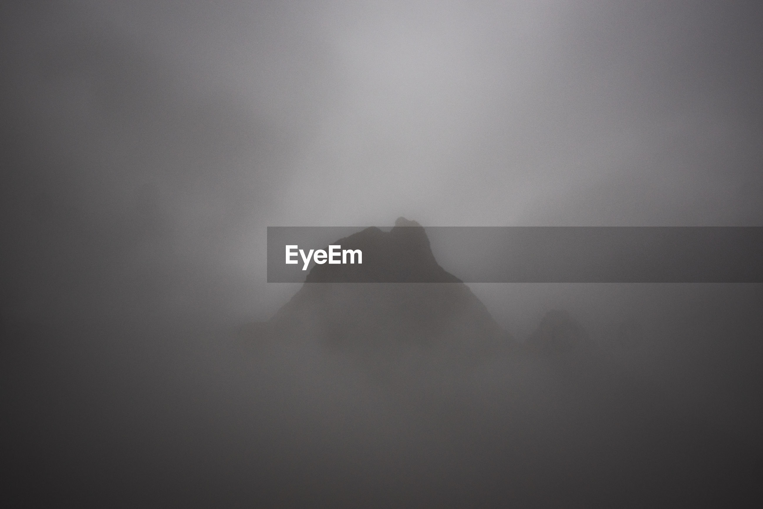 SILHOUETTE OF MOUNTAIN AGAINST SKY DURING FOGGY WEATHER