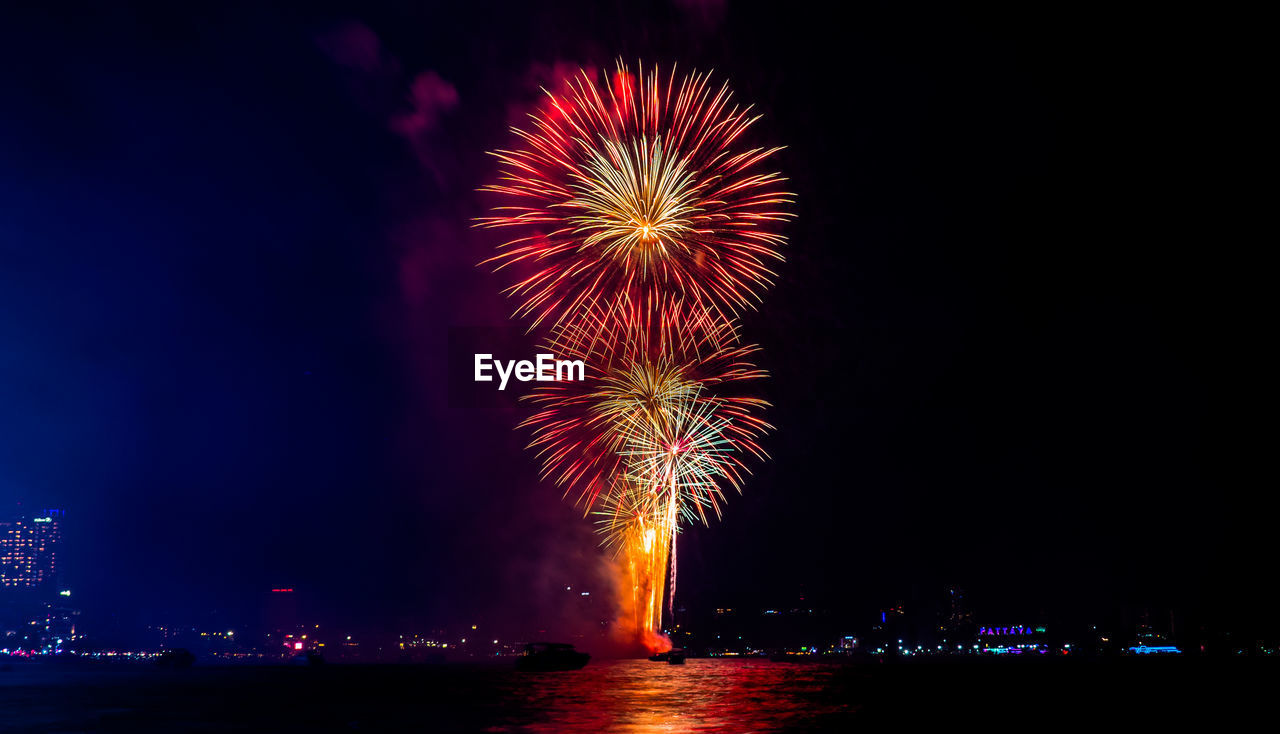 night, illuminated, firework, firework display, exploding, motion, celebration, event, arts culture and entertainment, sky, glowing, water, long exposure, firework - man made object, nature, no people, multi colored, architecture, blurred motion, outdoors, sparks, light