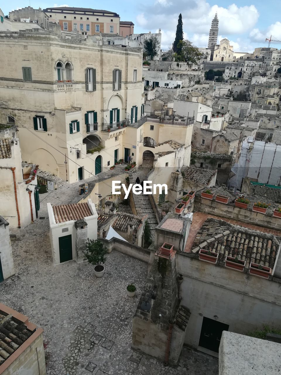 building exterior, built structure, architecture, building, city, residential district, high angle view, day, travel destinations, town, history, incidental people, nature, old, the past, belief, outdoors, religion, cityscape, townscape