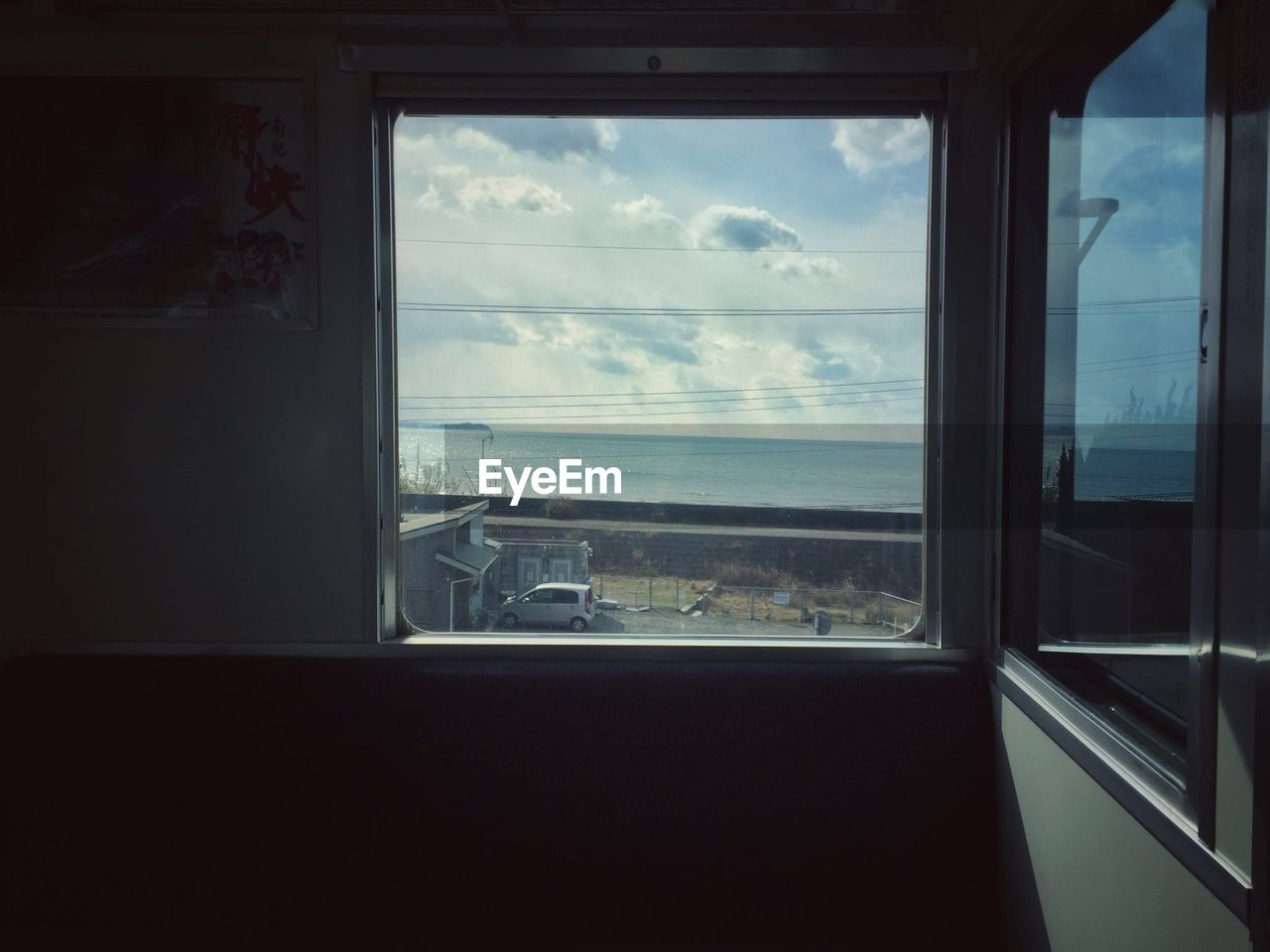 Scenic View Of Sea Seen Through Window