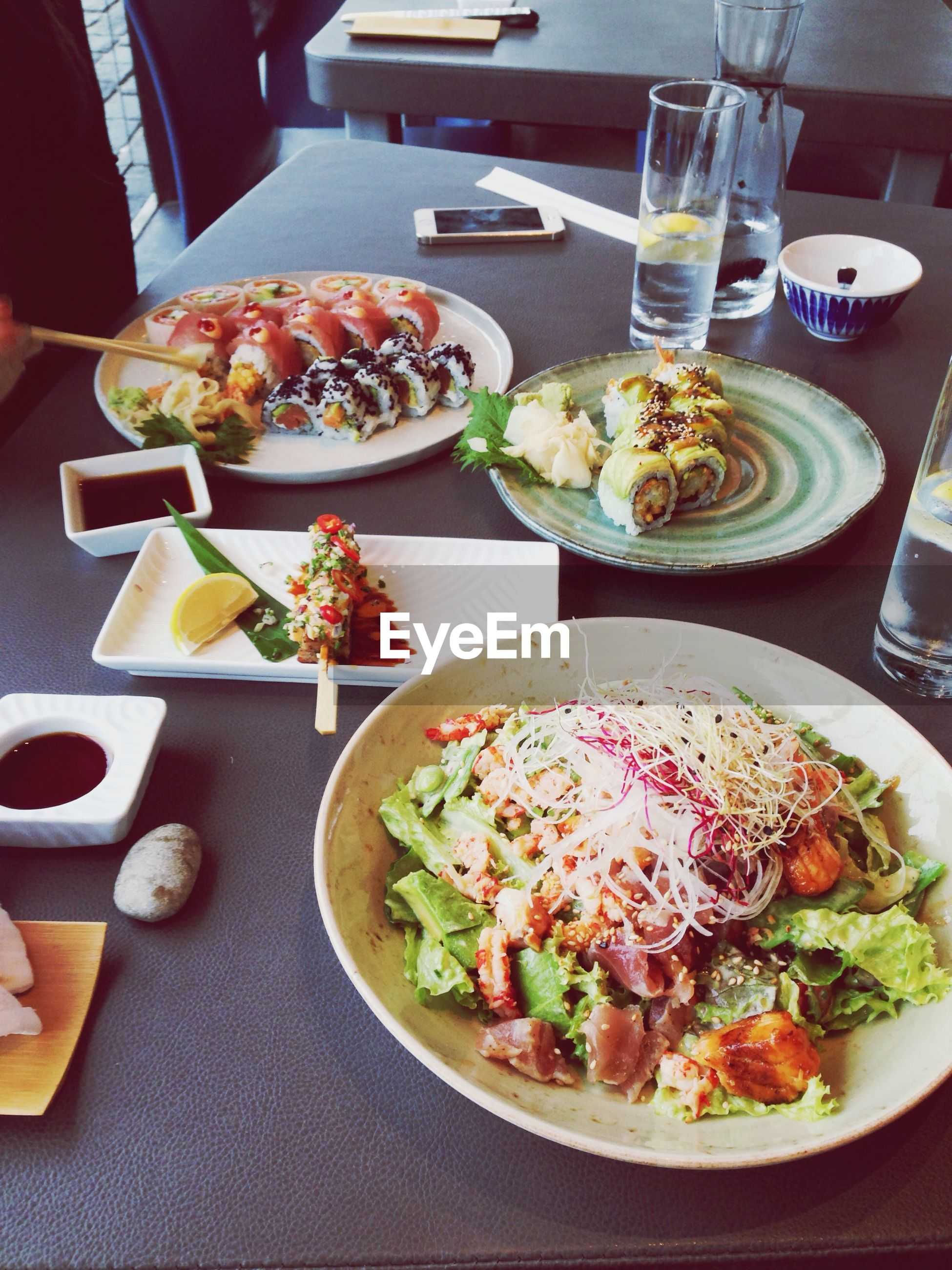 food and drink, indoors, food, table, plate, freshness, ready-to-eat, meal, healthy eating, drink, still life, serving size, drinking glass, bowl, salad, restaurant, fork, served, high angle view, refreshment