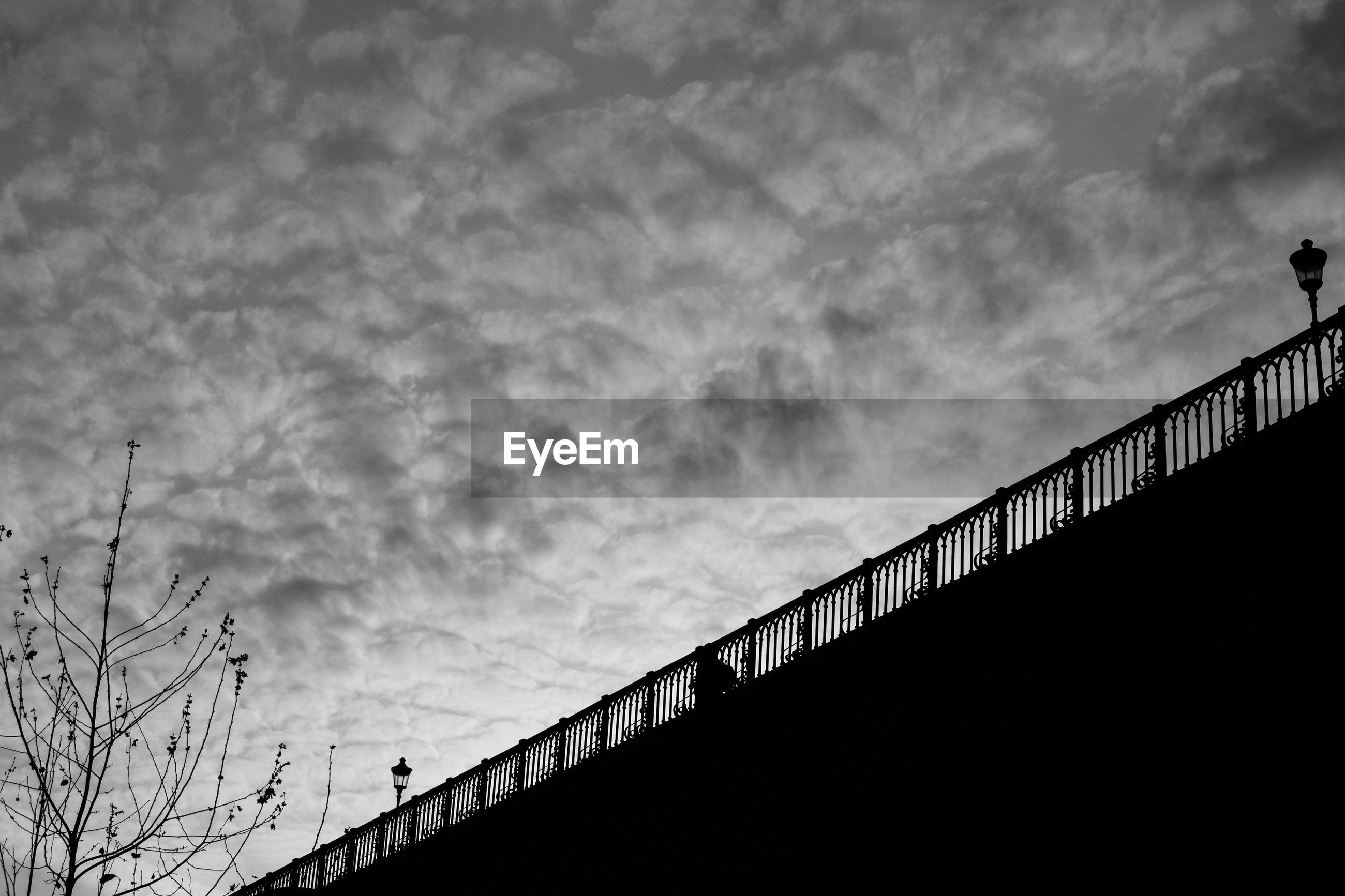 LOW ANGLE VIEW OF BRIDGE AGAINST SKY AT DUSK