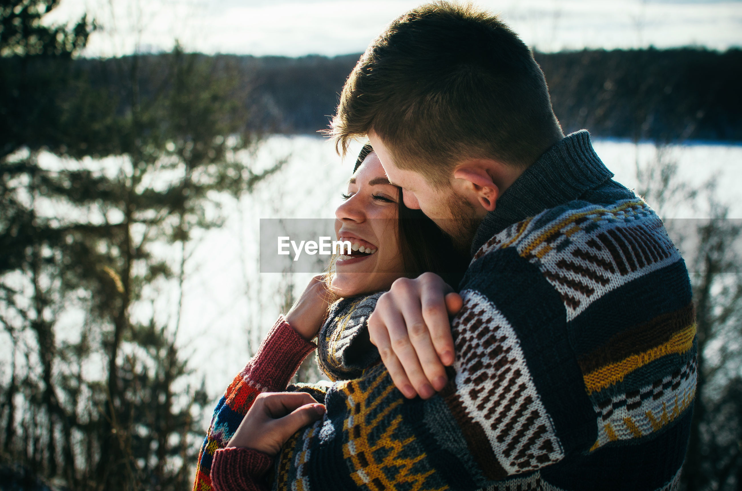 Young couple kissing in winter