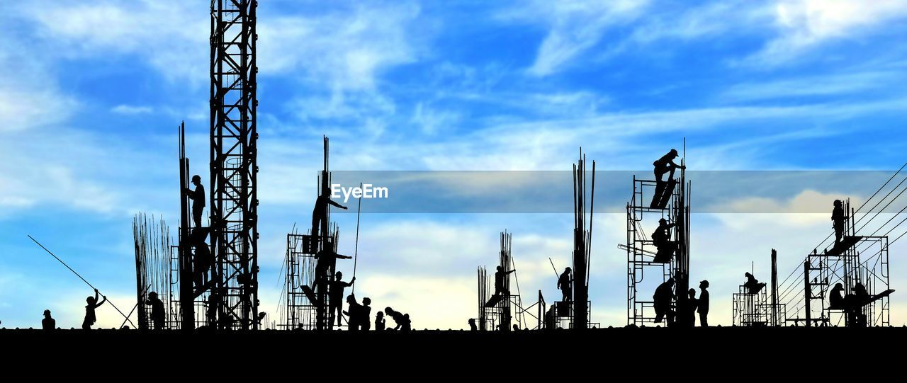 cloud - sky, sky, industry, silhouette, built structure, architecture, machinery, nature, technology, construction industry, low angle view, no people, communication, crane - construction machinery, outdoors, development, day, tower, fuel and power generation, global communications, industrial equipment, radio wave