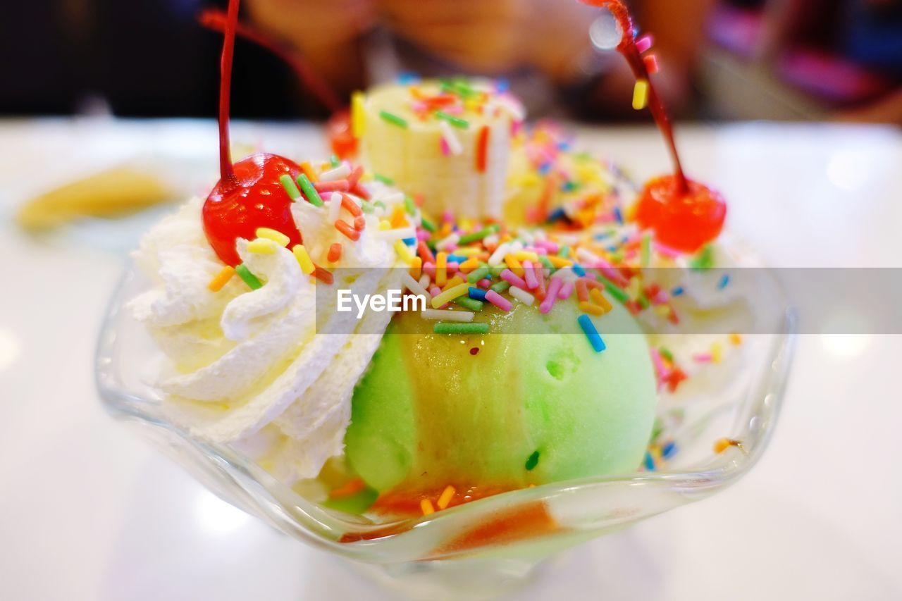 food and drink, food, sweet food, sweet, indulgence, dessert, multi colored, indoors, ready-to-eat, freshness, still life, temptation, unhealthy eating, close-up, focus on foreground, table, no people, serving size, selective focus, cake, glass