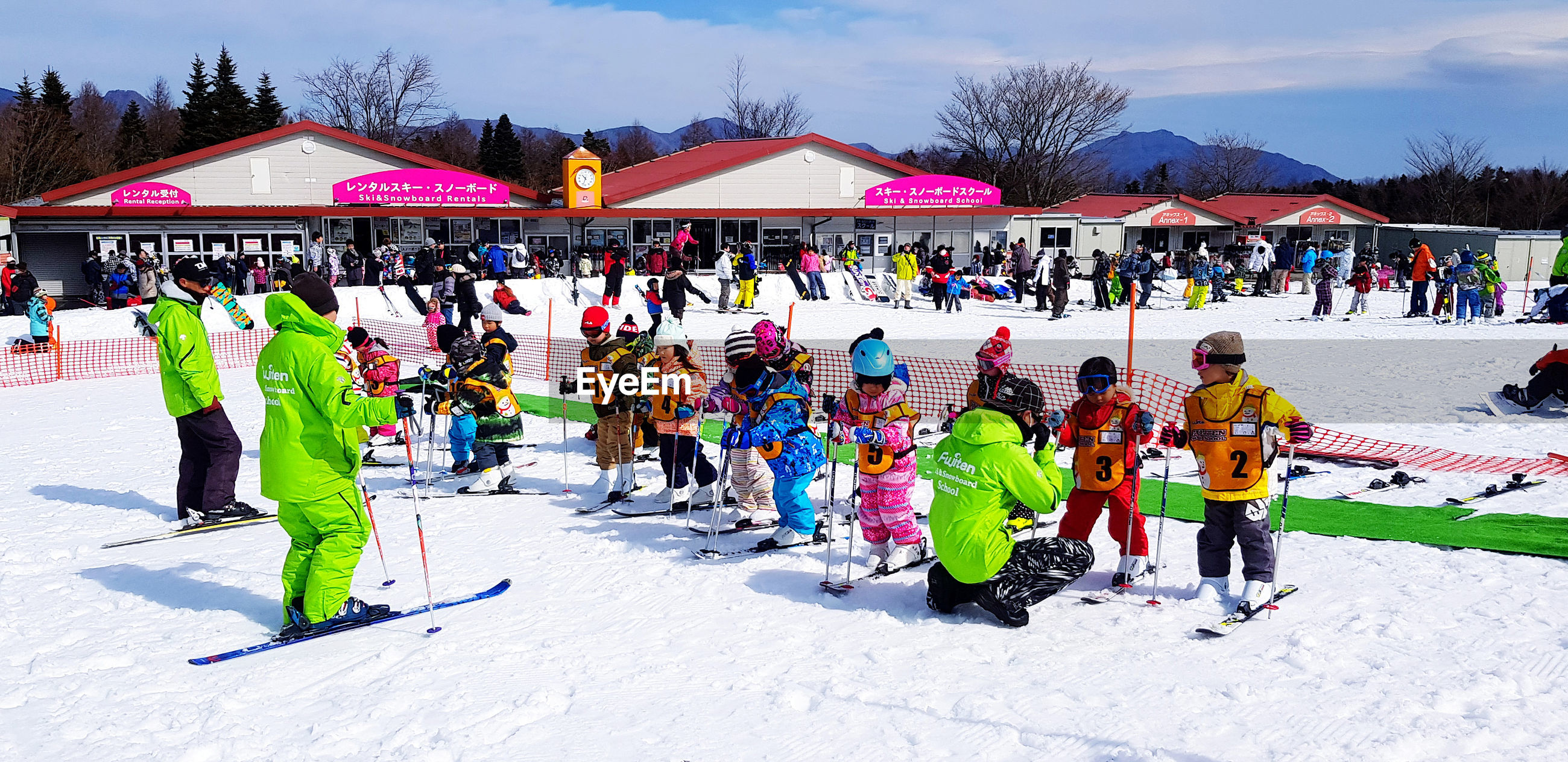 GROUP OF PEOPLE ENJOYING ON SNOW COVERED FIELD