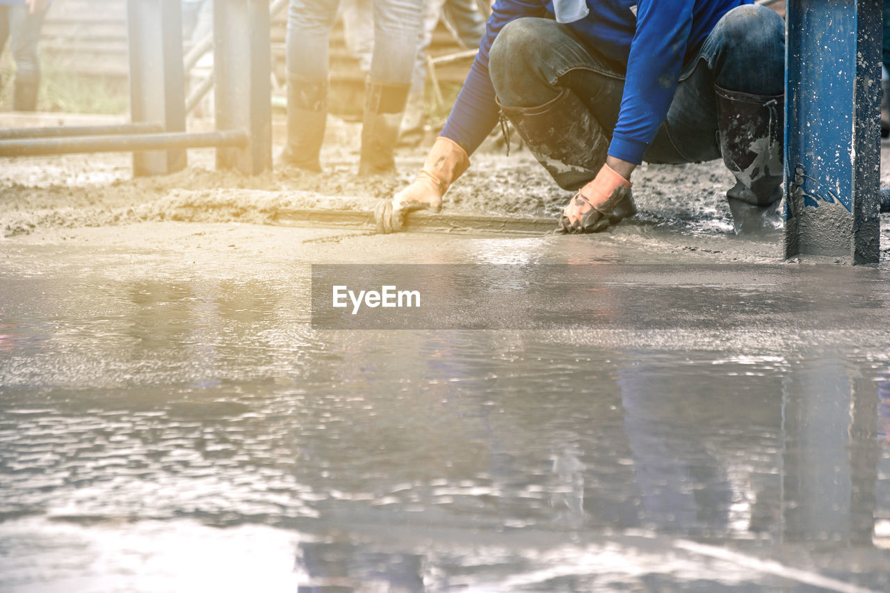 water, real people, men, wet, day, motion, low section, people, nature, leisure activity, lifestyles, waterfront, outdoors, human leg, human body part, sunlight, reflection, body part, selective focus