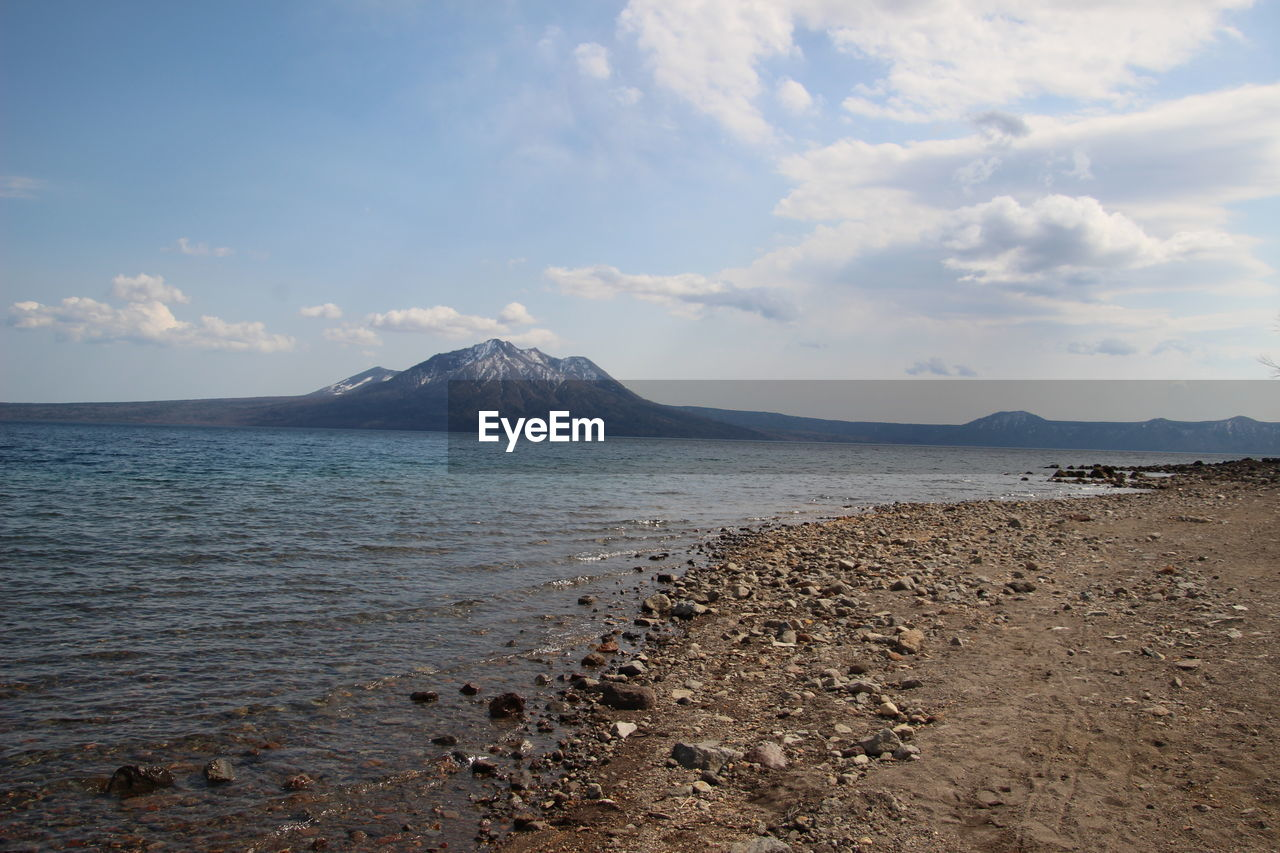 sky, cloud - sky, scenics - nature, beauty in nature, mountain, tranquil scene, tranquility, water, sea, land, nature, non-urban scene, beach, idyllic, no people, day, remote, volcano, outdoors, mountain peak, volcanic crater