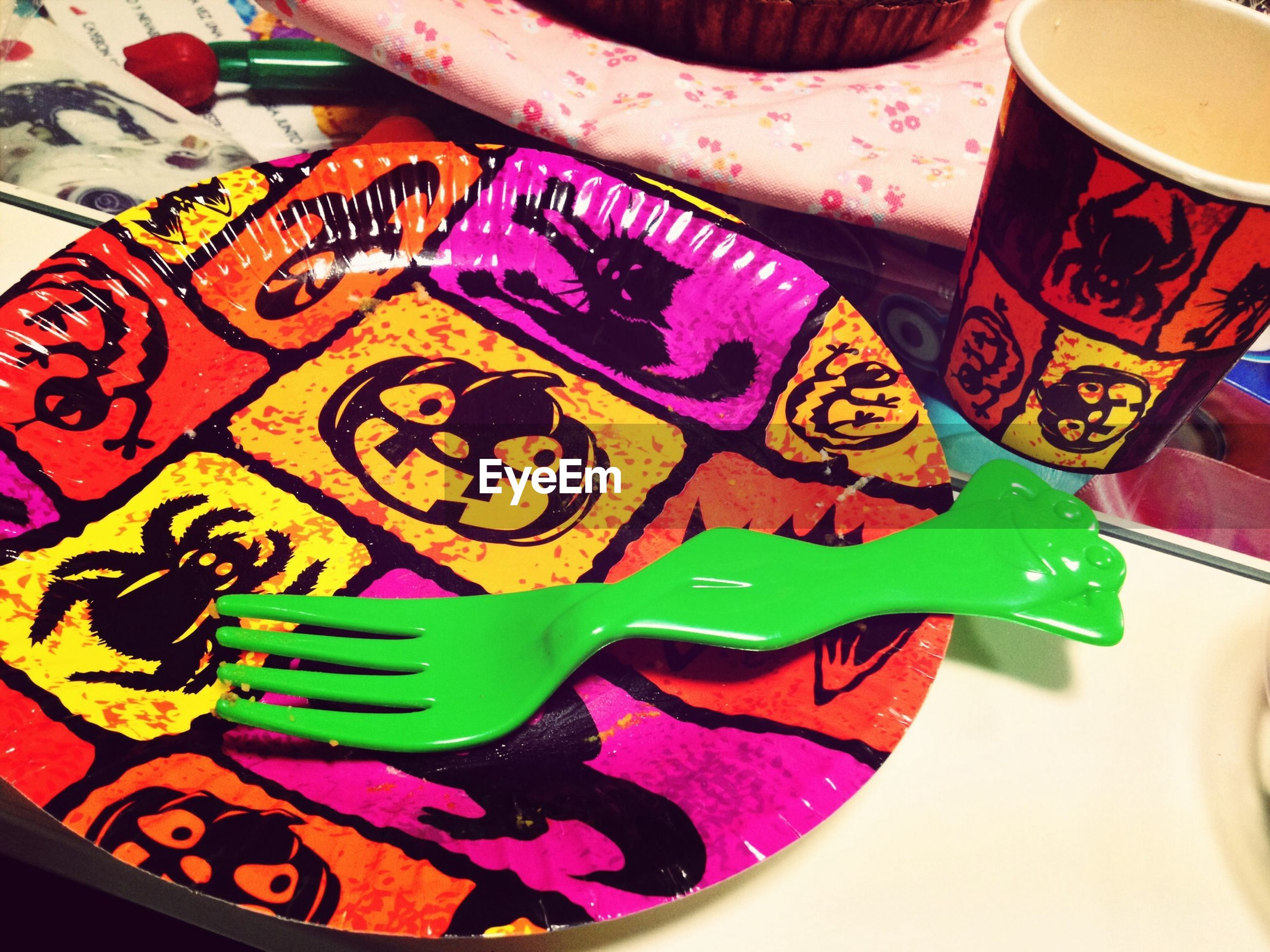 indoors, still life, creativity, art and craft, multi colored, art, table, high angle view, variation, close-up, floral pattern, design, craft, no people, animal representation, choice, pattern, paper, colorful, food and drink