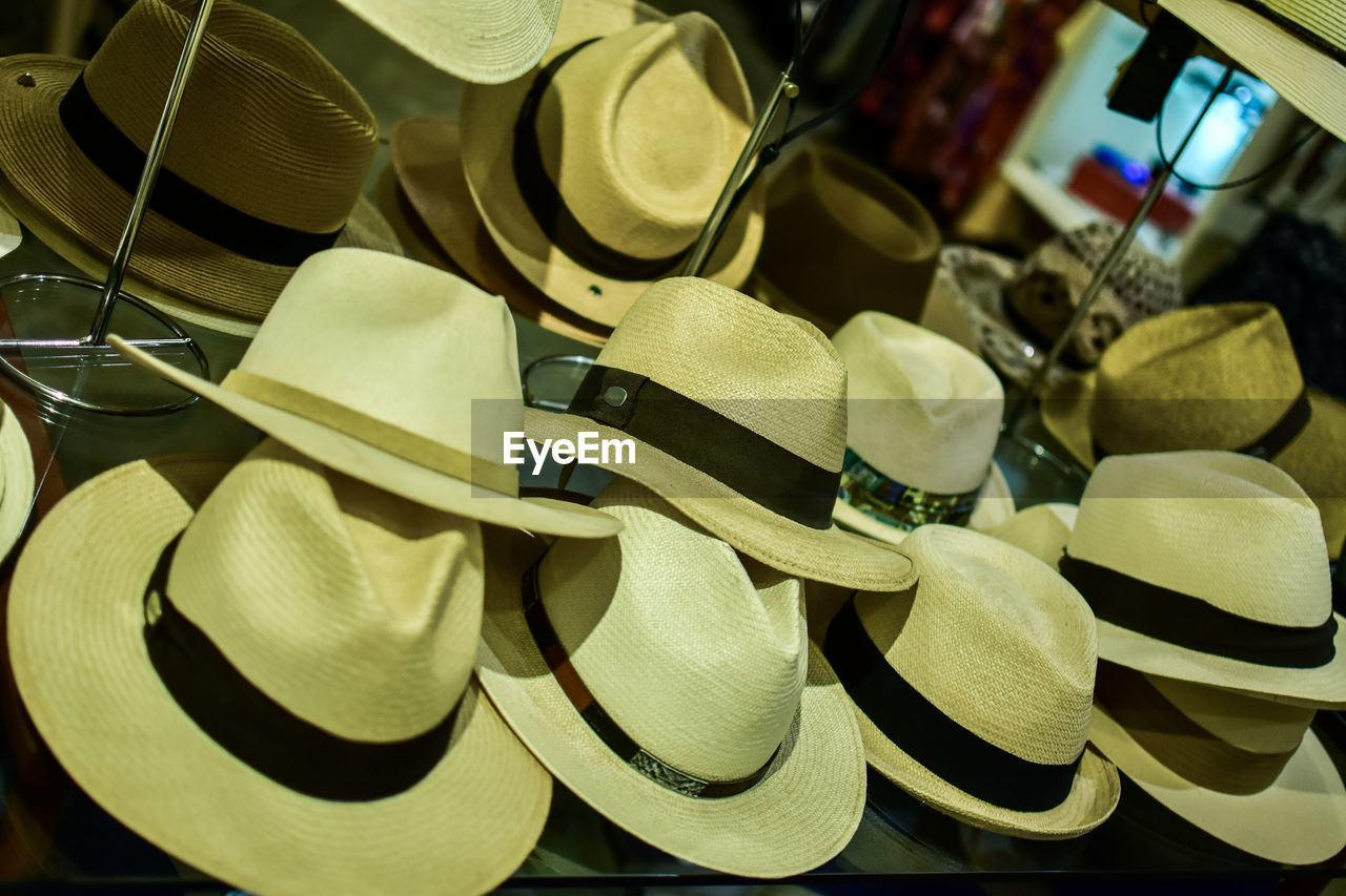 large group of objects, close-up, no people, still life, choice, abundance, indoors, variation, retail, backgrounds, full frame, fashion, for sale, shopping, multi colored, store, hat, retail display, shape, collection, personal accessory, consumerism