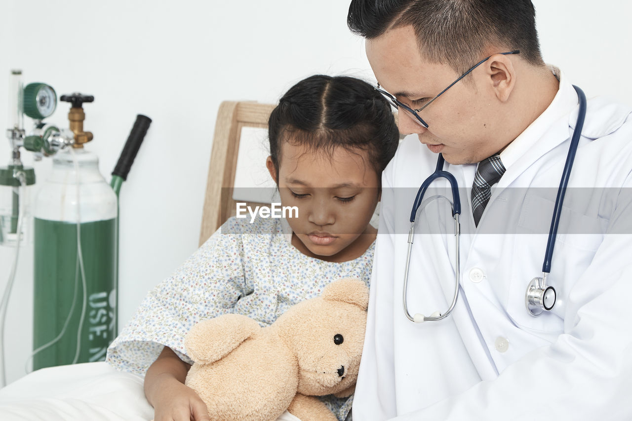 Close-up of doctor and patient at home
