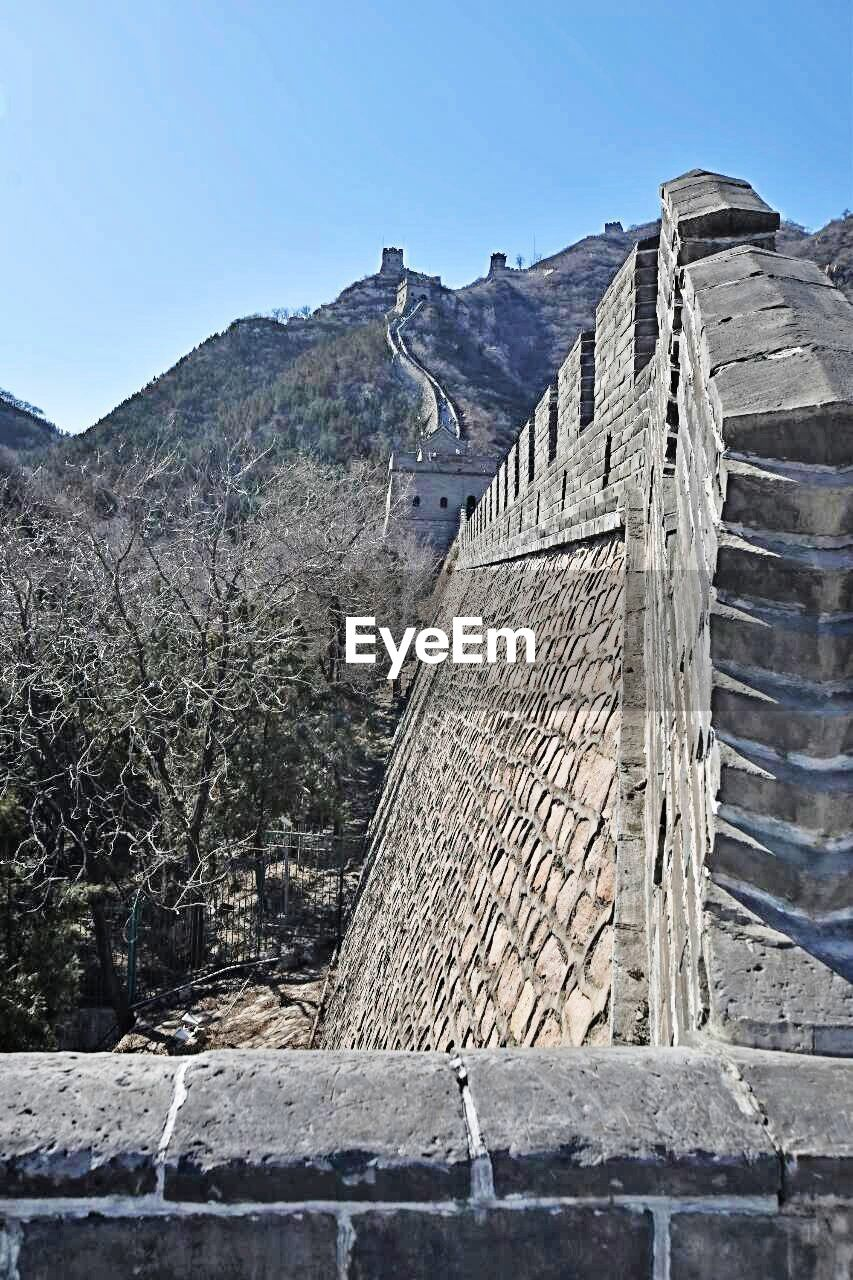 Low angle view of great wall of china against clear sky
