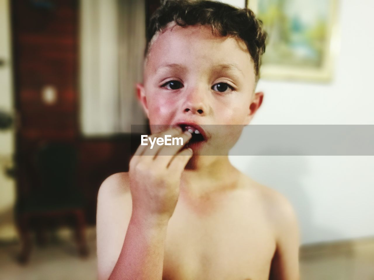Close-up portrait of boy eating