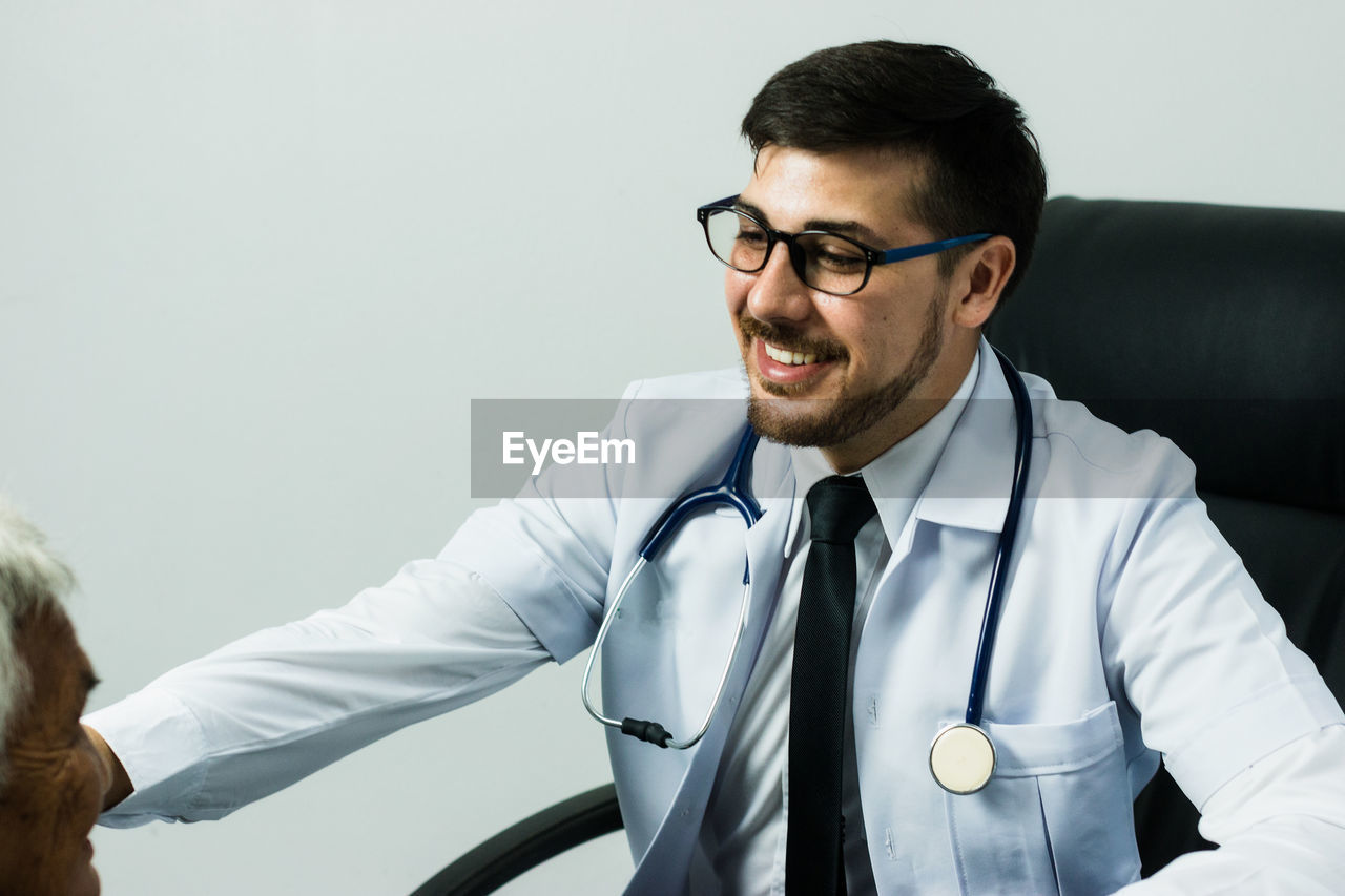 Doctor Talking To Patient In Medical Clinic