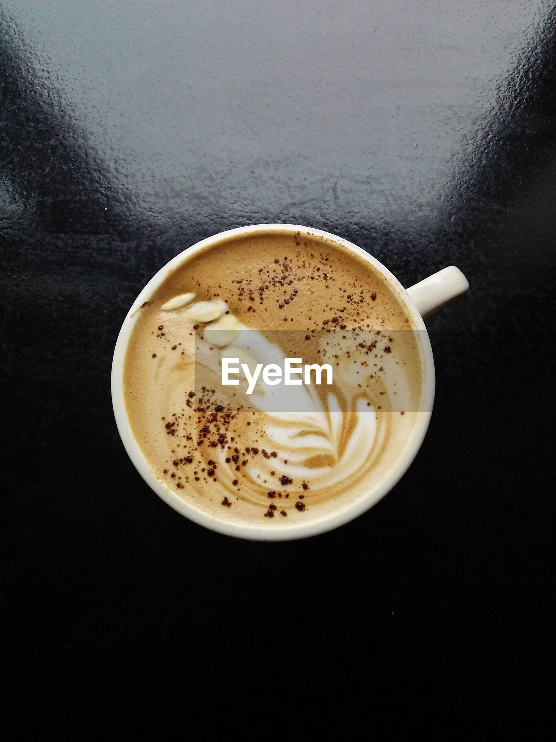 Overhead view of coffee cup on table