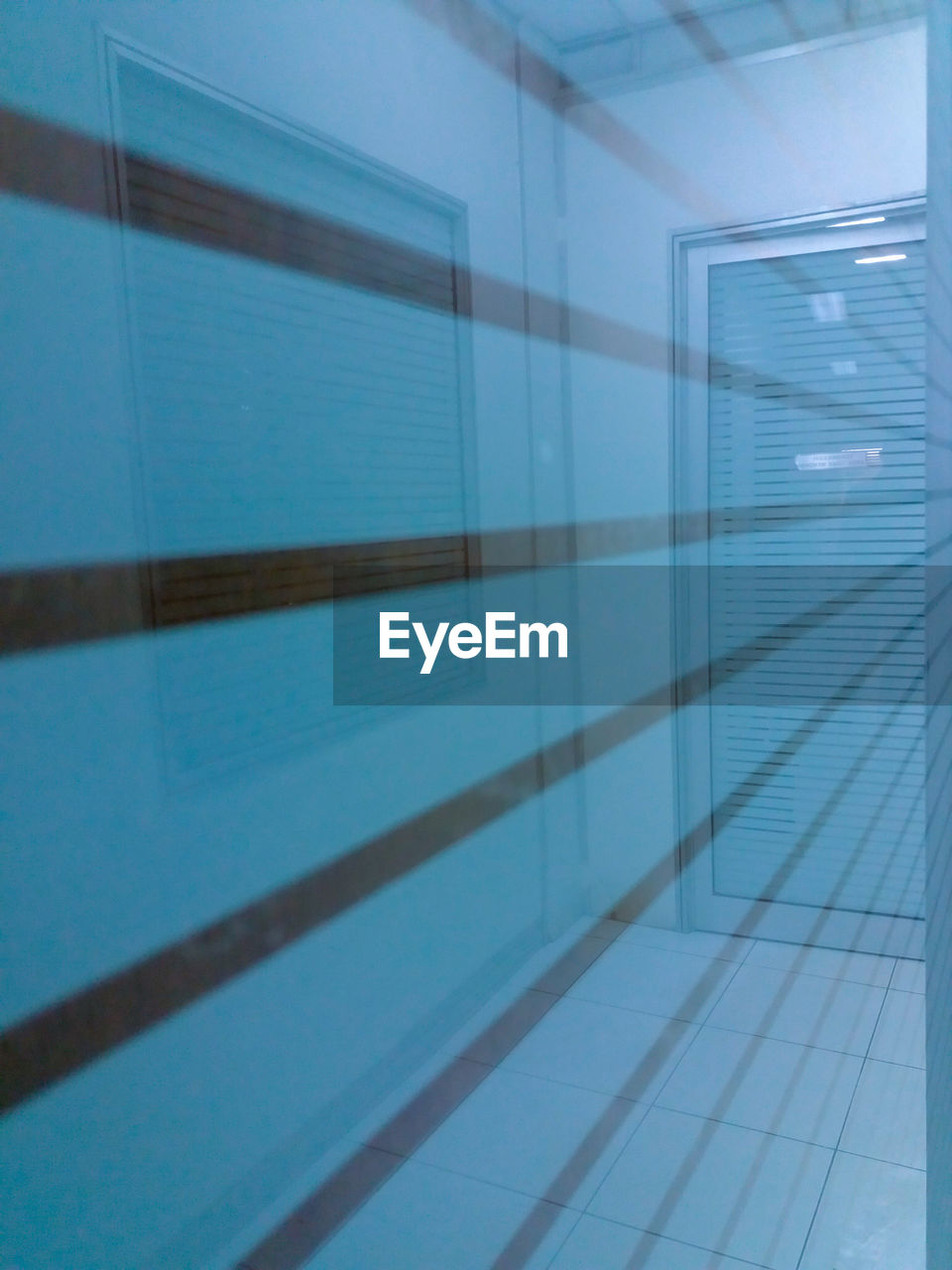 architecture, flooring, tile, no people, built structure, indoors, wall - building feature, blue, swimming pool, reflection, pool, day, pattern, glass - material, building, full frame, window, tiled floor, sunlight