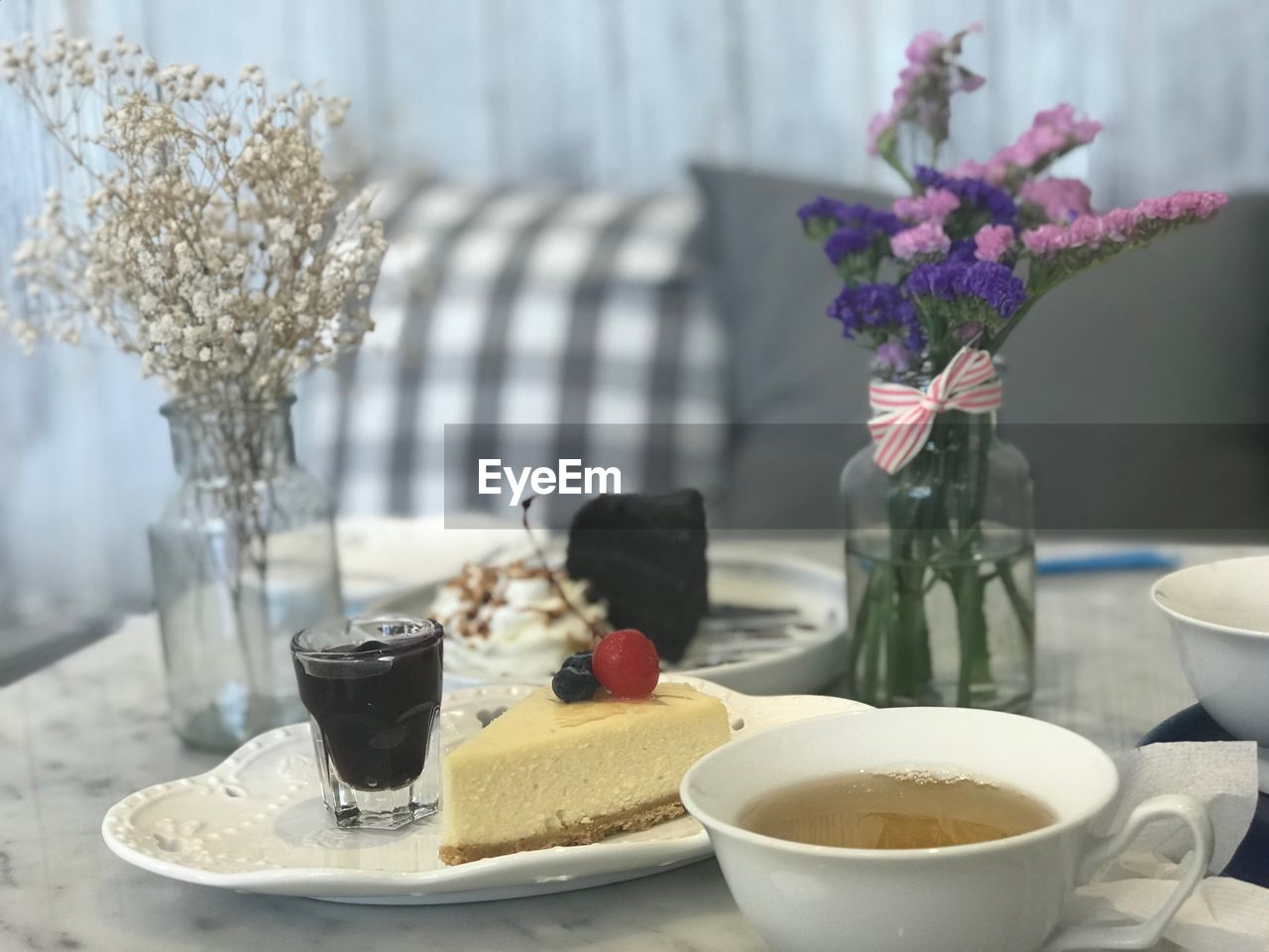 table, freshness, food and drink, drink, vase, flower, flowering plant, food, refreshment, plant, no people, plate, cup, ready-to-eat, still life, focus on foreground, coffee cup, mug, nature, indoors, glass, breakfast, meal, temptation, flower arrangement