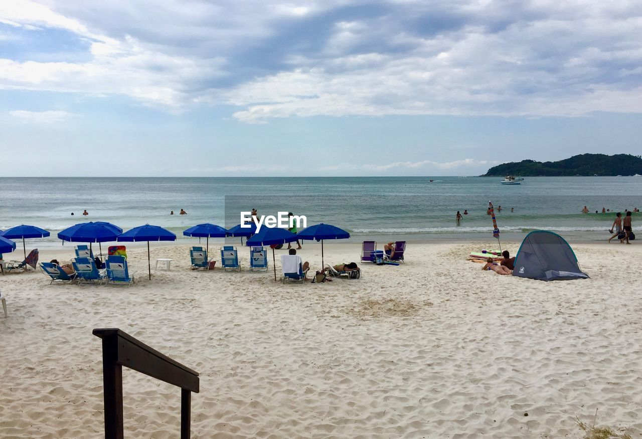 beach, land, sand, sea, water, sky, cloud - sky, horizon, chair, horizon over water, beauty in nature, nature, tranquil scene, scenics - nature, tranquility, parasol, day, seat, umbrella, outdoors
