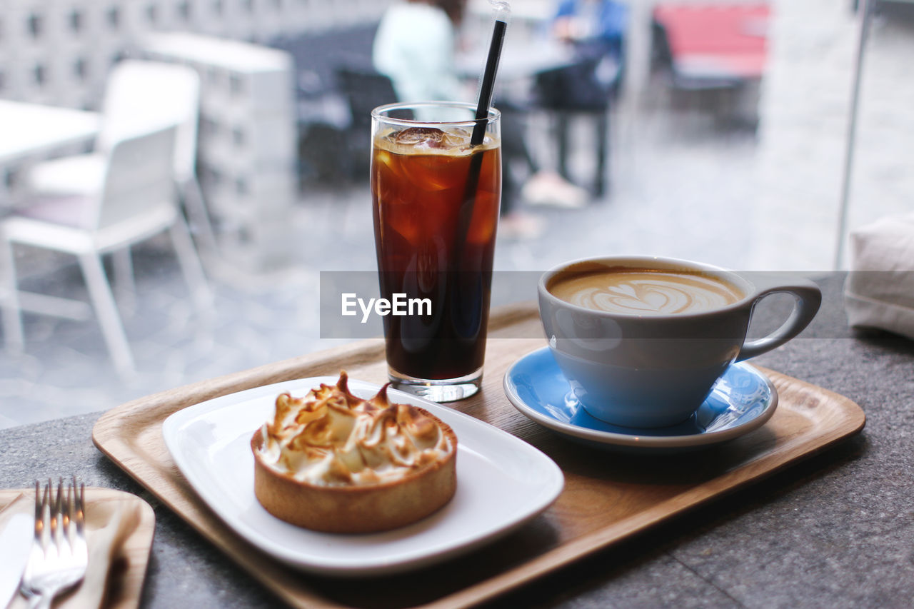 Close-Up Of Coffee And Breakfast Served On Table In Restaurant