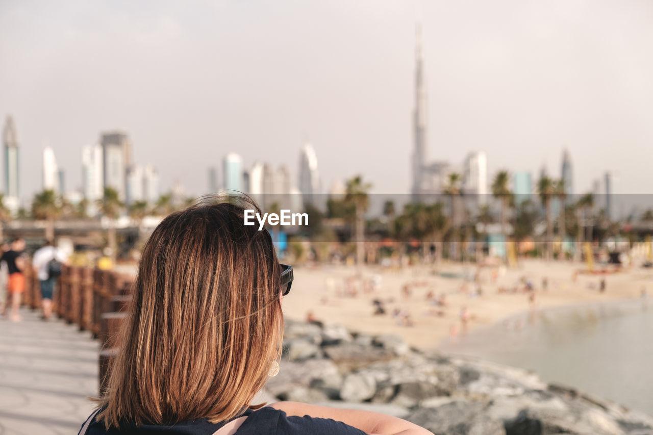 Portrait of woman looking at dubai skyline