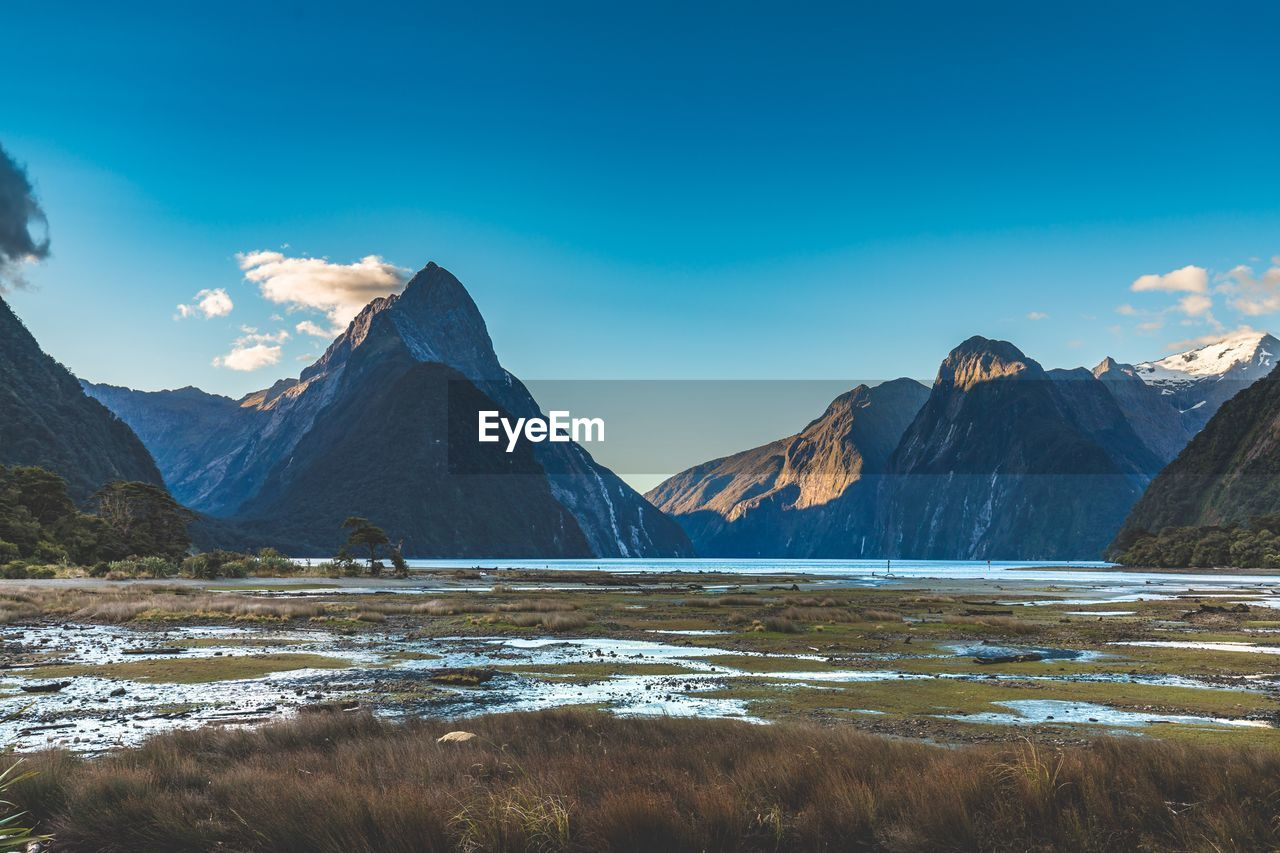 mountain, beauty in nature, sky, water, scenics - nature, tranquil scene, tranquility, mountain range, non-urban scene, nature, lake, idyllic, cloud - sky, landscape, environment, day, remote, cold temperature, no people, outdoors, snowcapped mountain, mountain peak