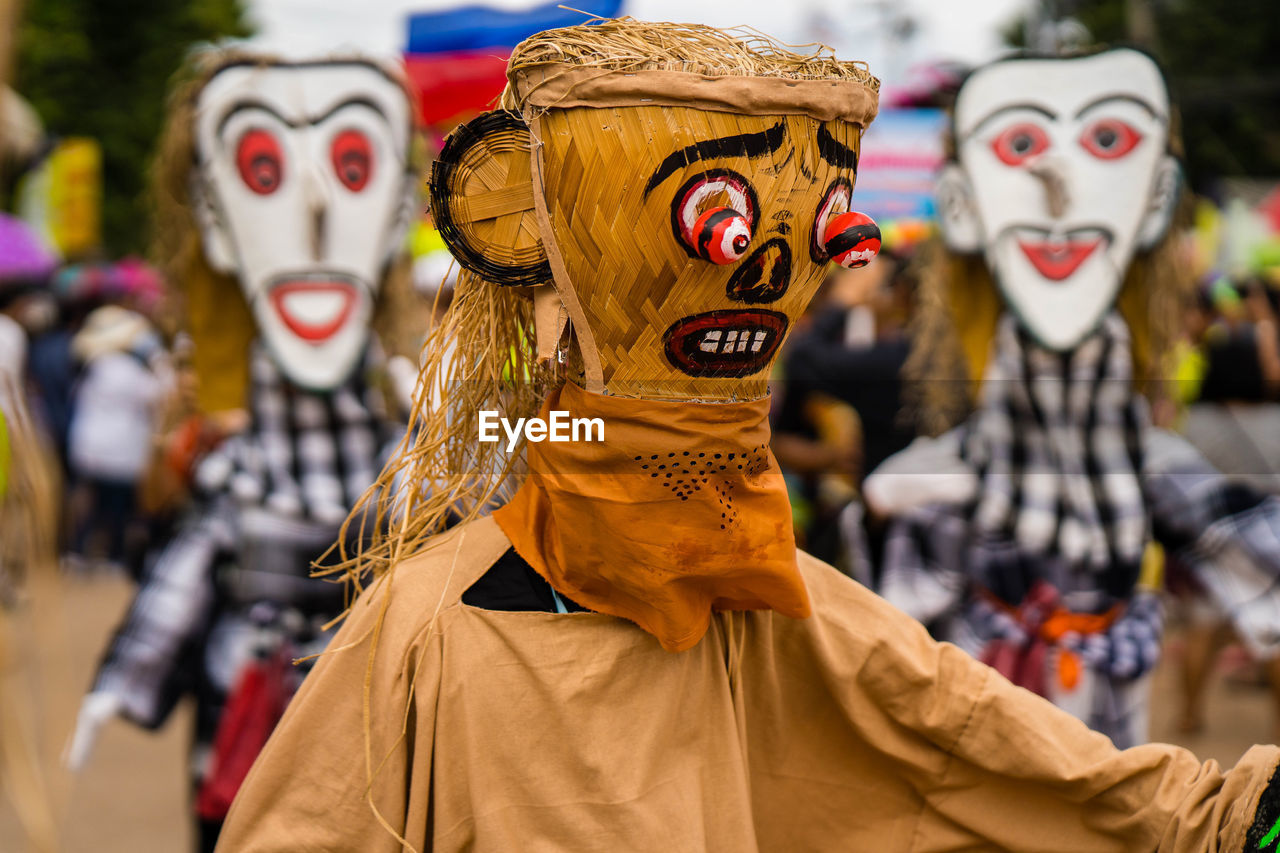 representation, human representation, focus on foreground, disguise, creativity, mask, mask - disguise, real people, day, art and craft, people, outdoors, celebration, costume, incidental people, toy, clothing, carnival - celebration event, festival