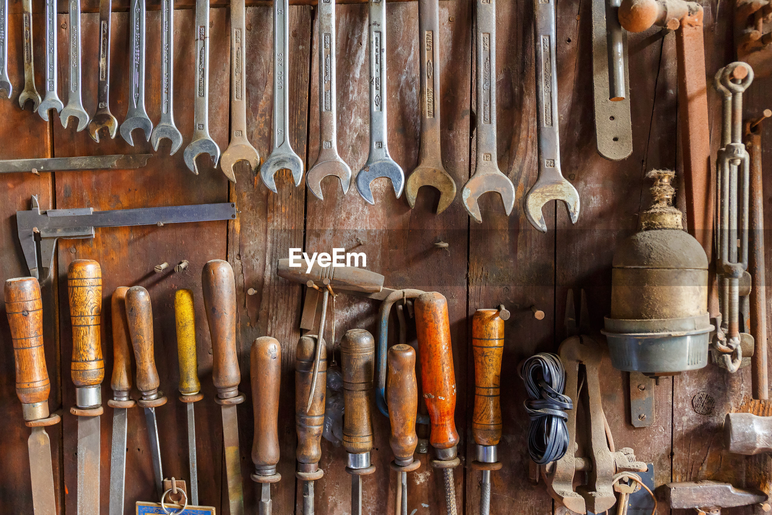 Directly above shot of various work tools on table at workshop