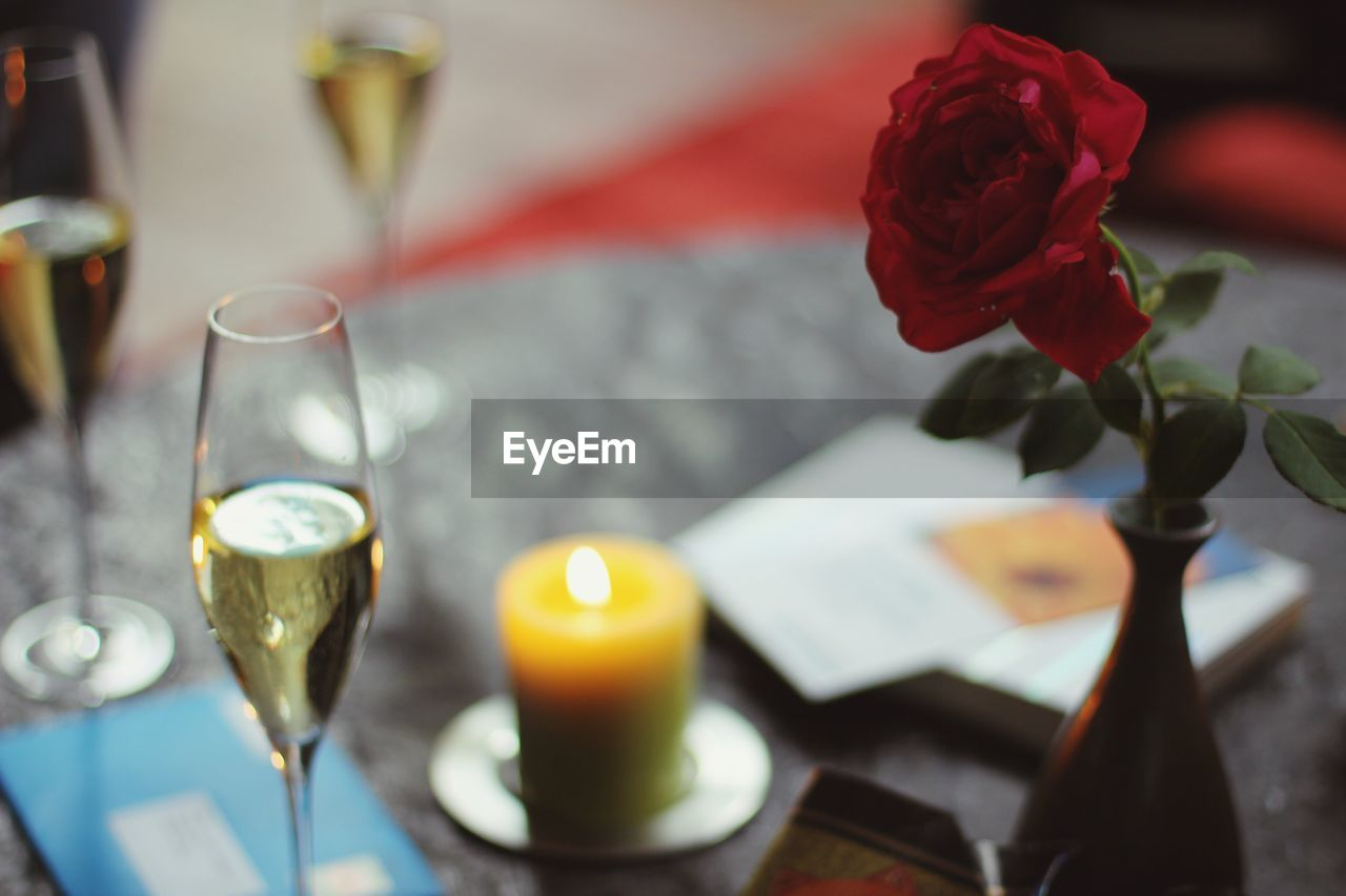 candle, flame, no people, table, rose - flower, flower, focus on foreground, indoors, close-up, freshness, nature, day