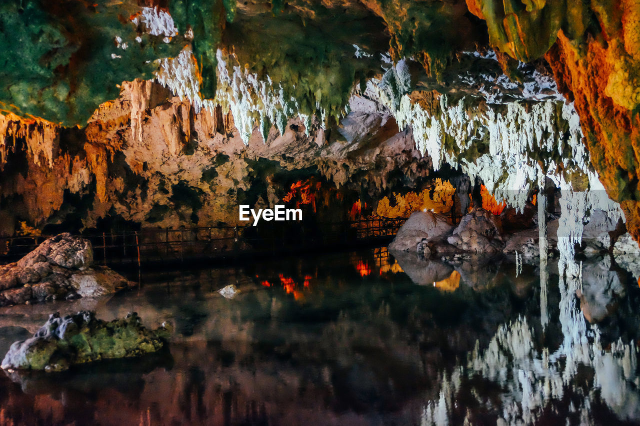 water, rock, solid, cave, rock - object, reflection, rock formation, geology, nature, no people, physical geography, stalactite, indoors, lake, beauty in nature, waterfront, motion, day, eroded