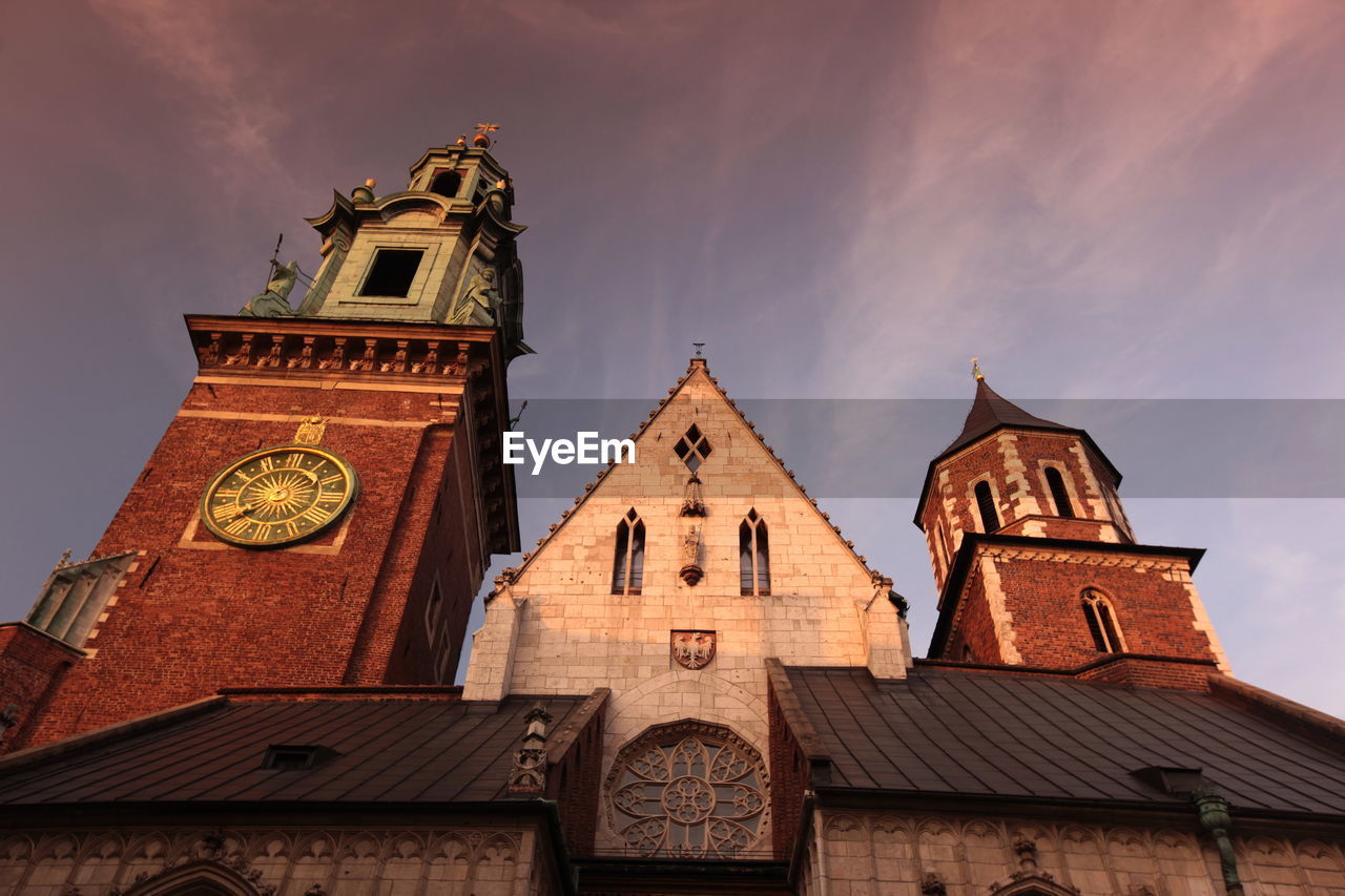 Low angle view of wawel cathedral against sky during sunset