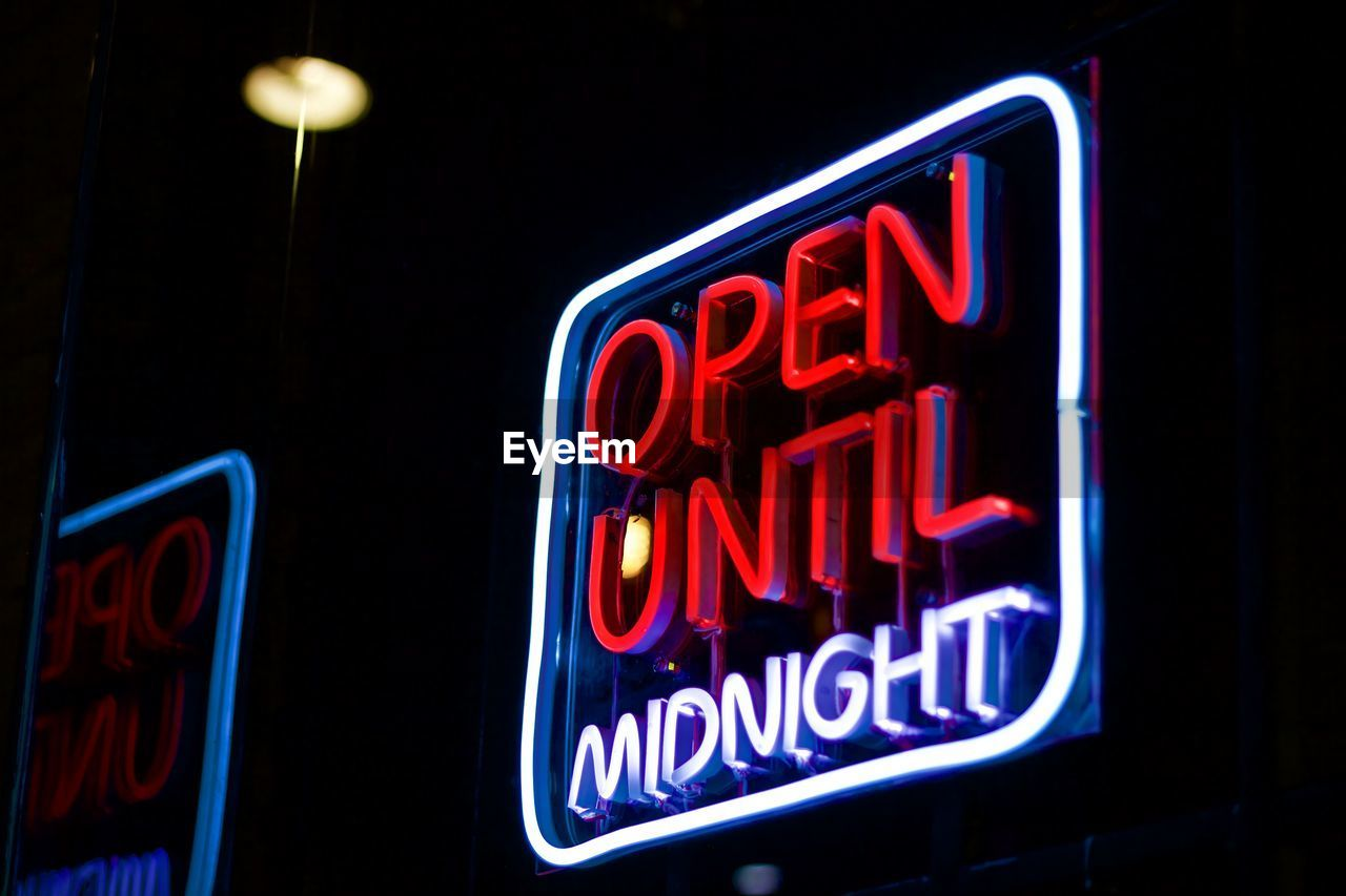illuminated, text, night, neon, western script, communication, no people, lighting equipment, sign, red, open sign, glowing, close-up, dark, black background, open, retail, store, commercial sign, information, nightlife, marketing, consumerism