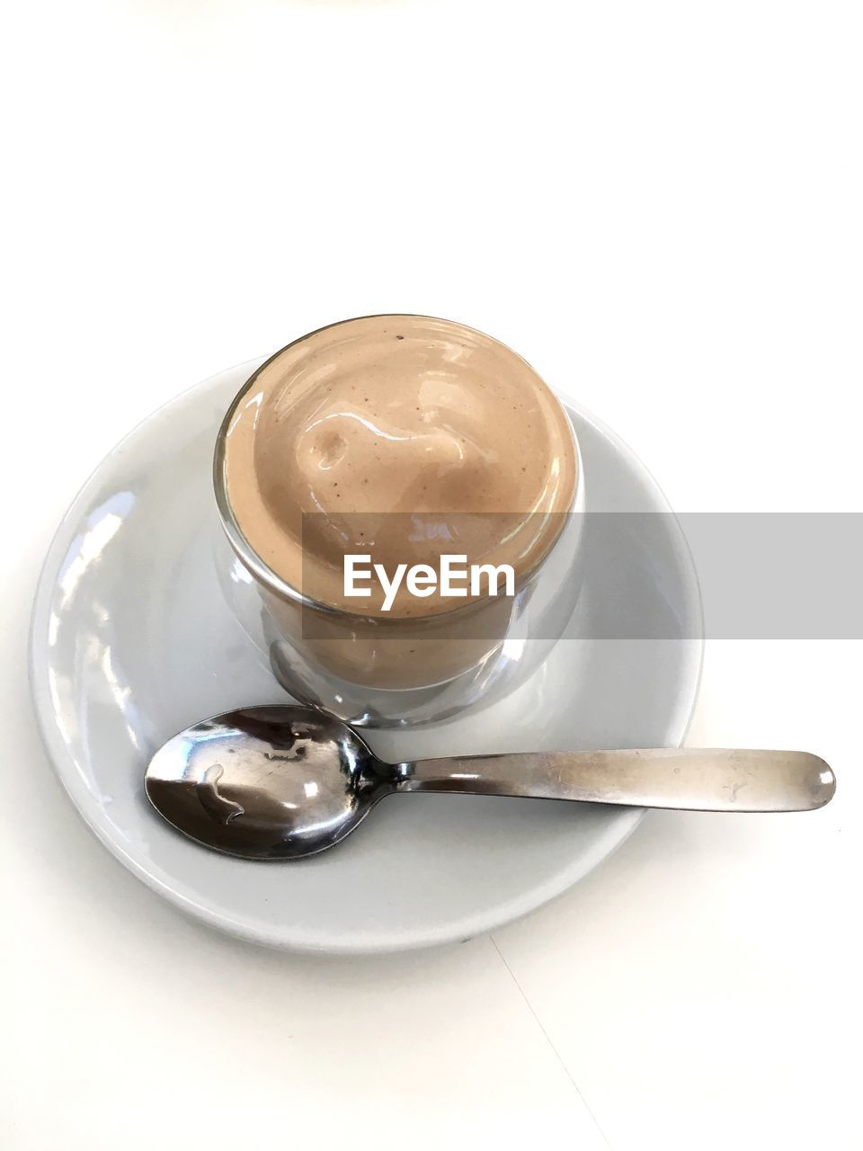 spoon, food and drink, coffee, white background, eating utensil, coffee - drink, kitchen utensil, coffee cup, cup, drink, still life, mug, saucer, crockery, studio shot, food, indoors, refreshment, freshness, close-up, no people, hot drink, frothy drink, latte, temptation