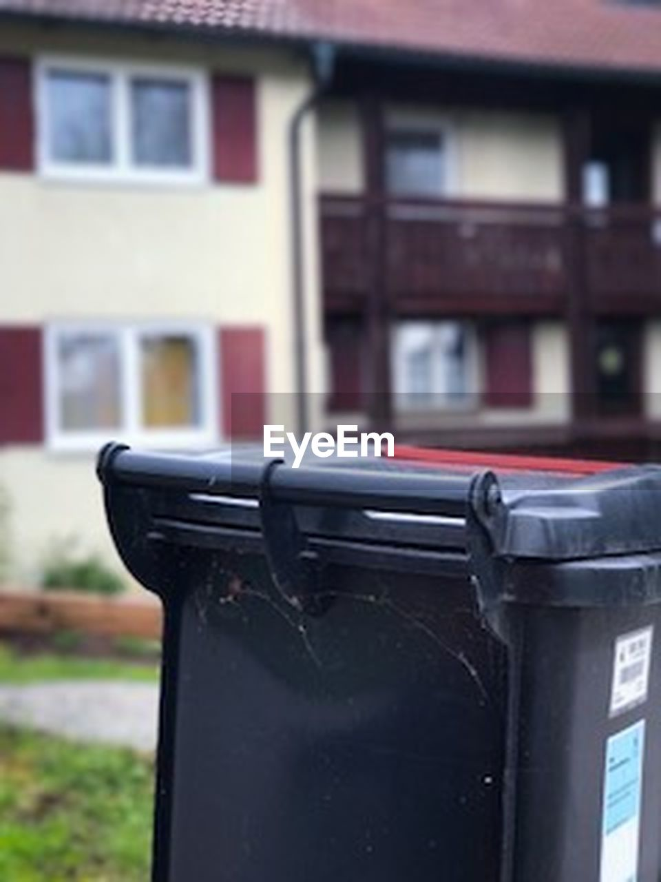 garbage, garbage bin, garbage can, container, focus on foreground, building exterior, no people, built structure, outdoors, aluminum, day, architecture, close-up