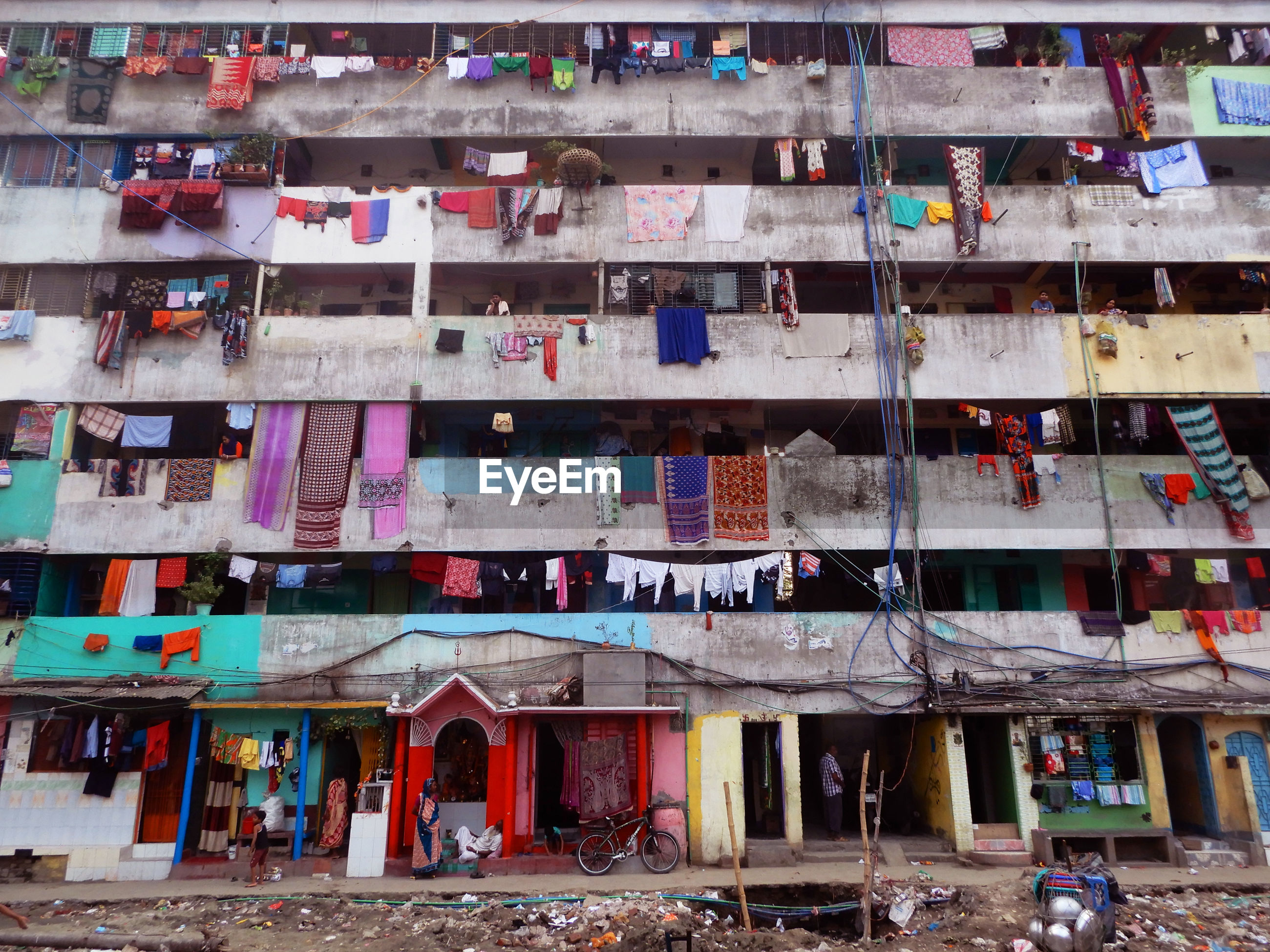 Low angle view of laundry hanging in balcony of building