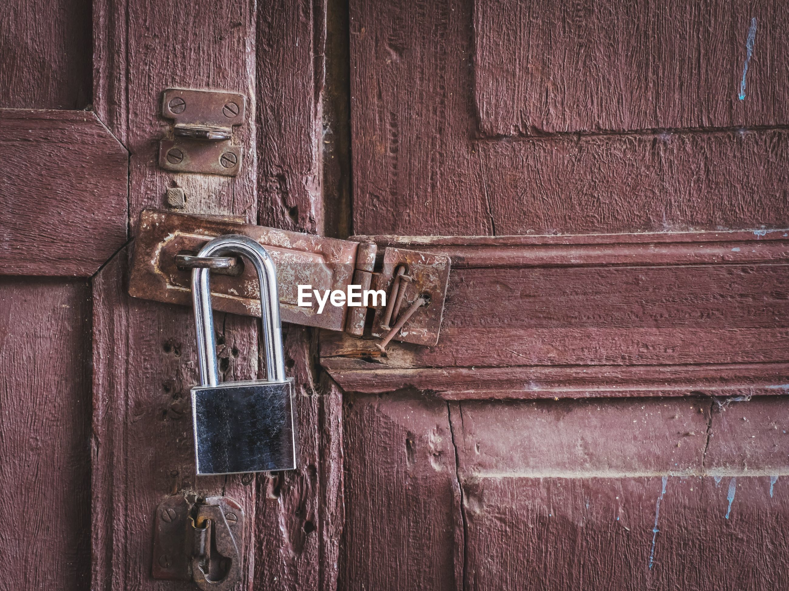 New lock on old red wooden doors